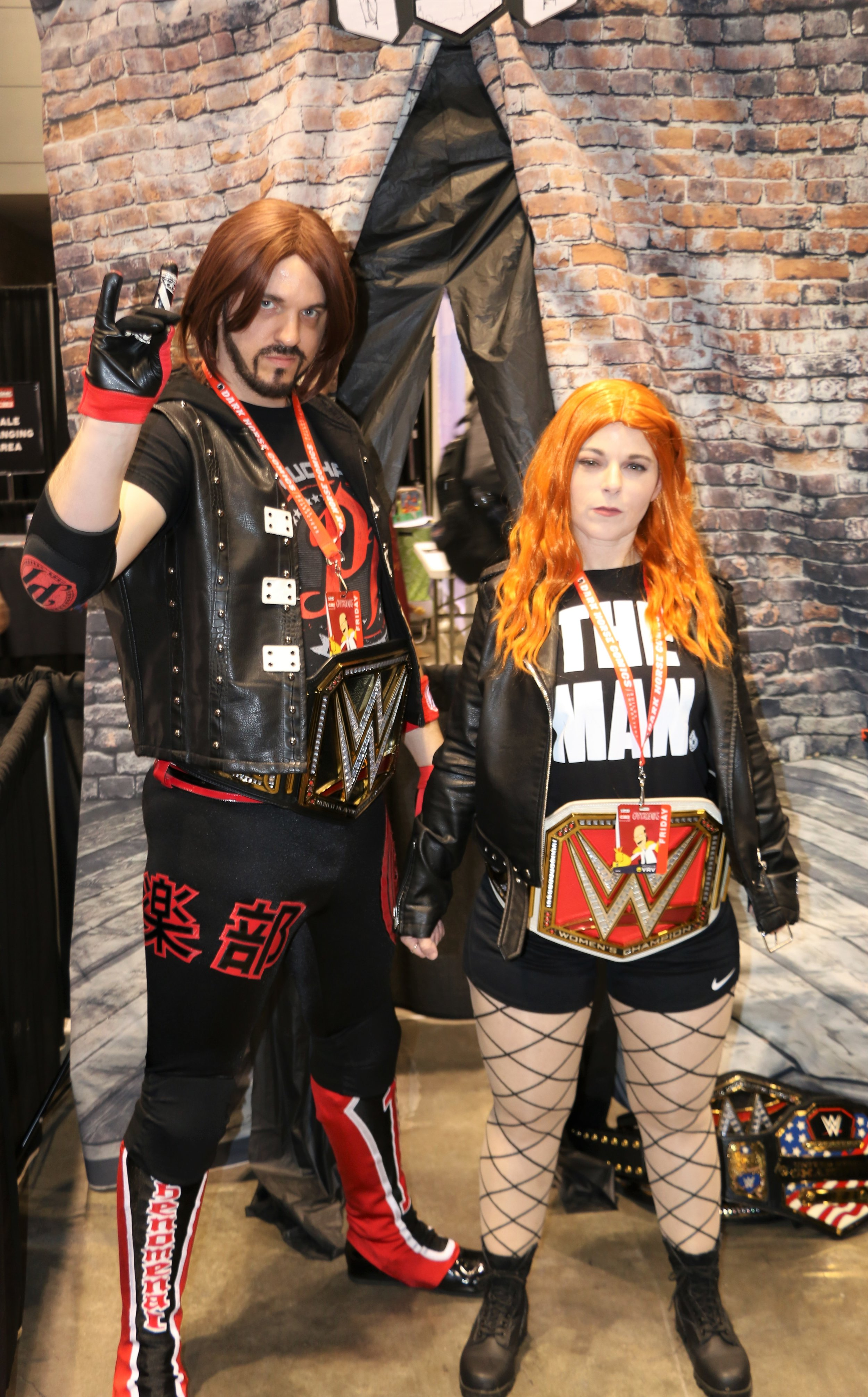 AJ Styles and Becky Lynch cosplayers at the Two Sweet Cosplay booth.