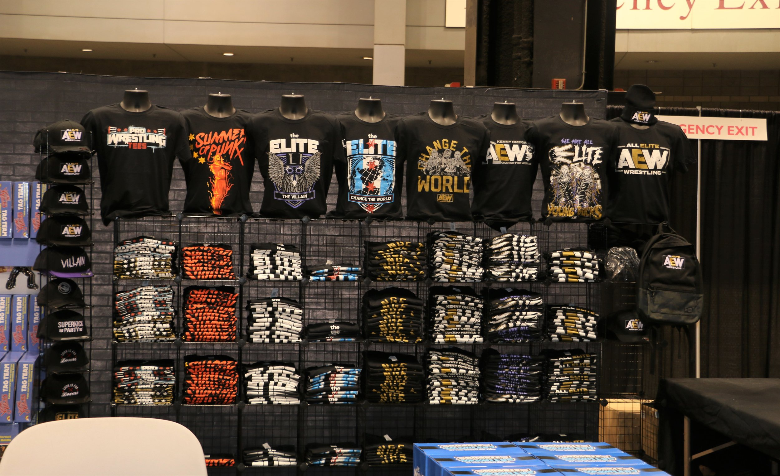Pro Wrestling Tees booth stocked with T-shirts.