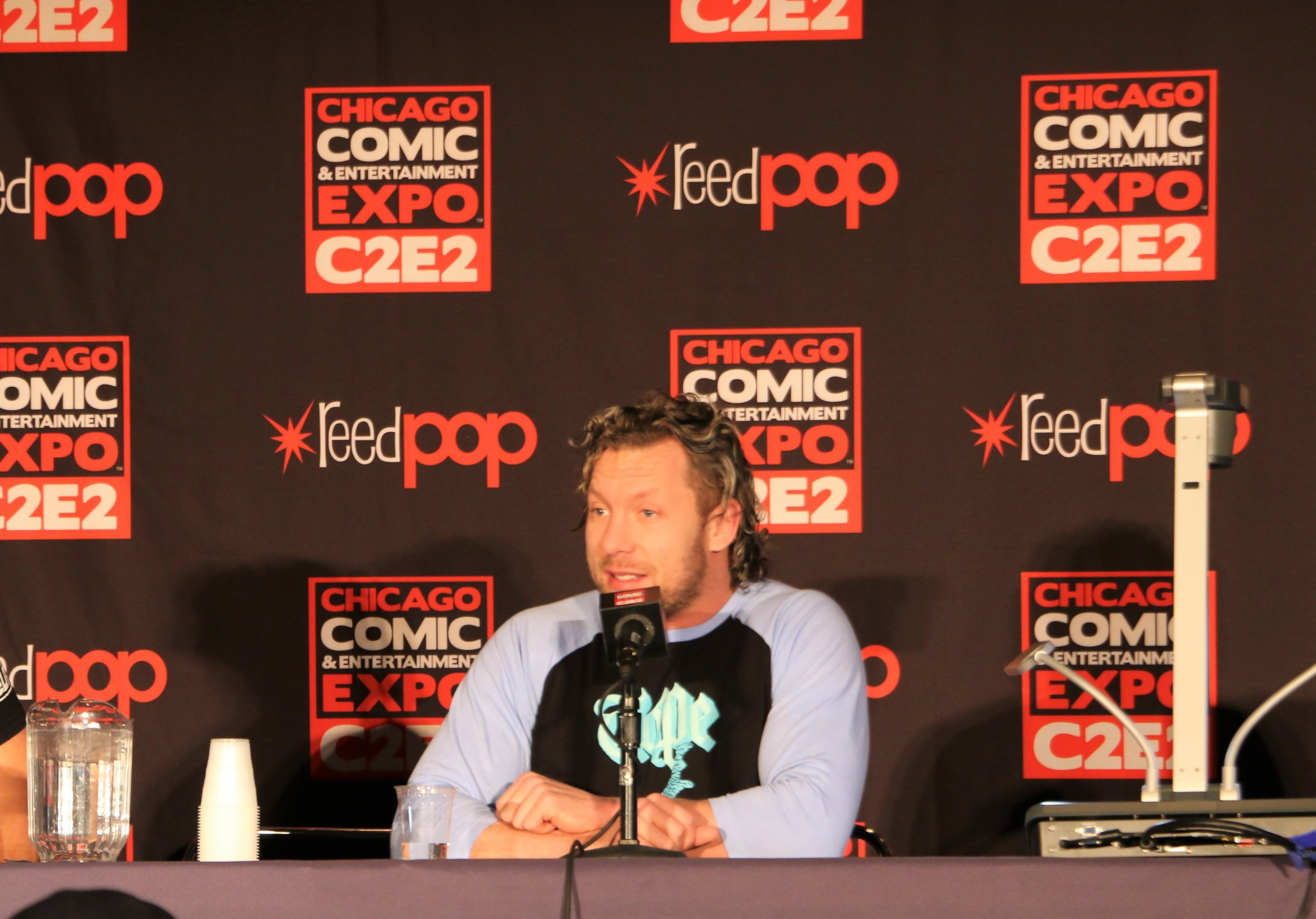 Kenny Omega answers a fan question during the All Elite Wrestling panel.