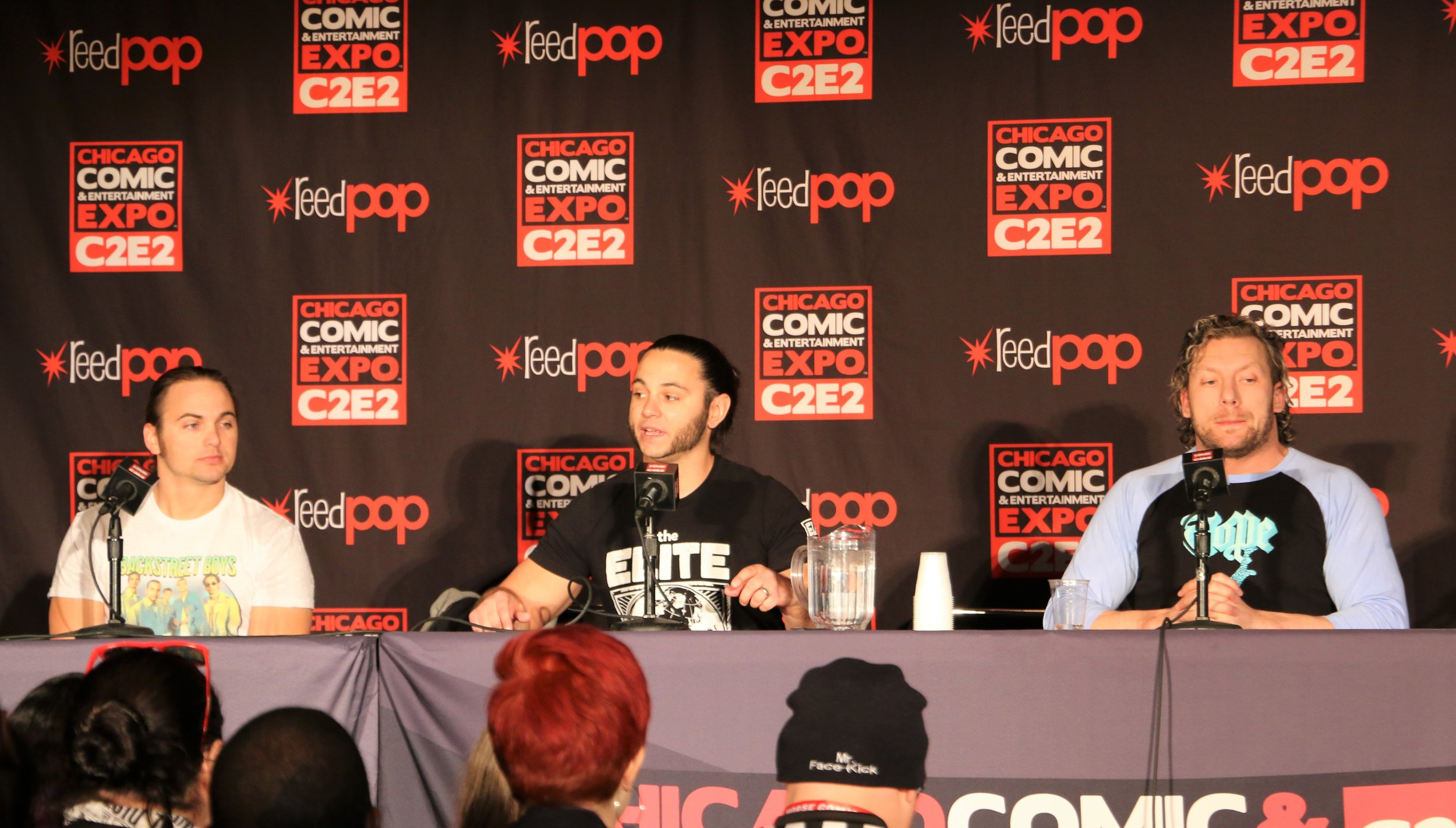 Nick and Matt Jackson and Kenny Omega during the All Elite Wrestling panel.