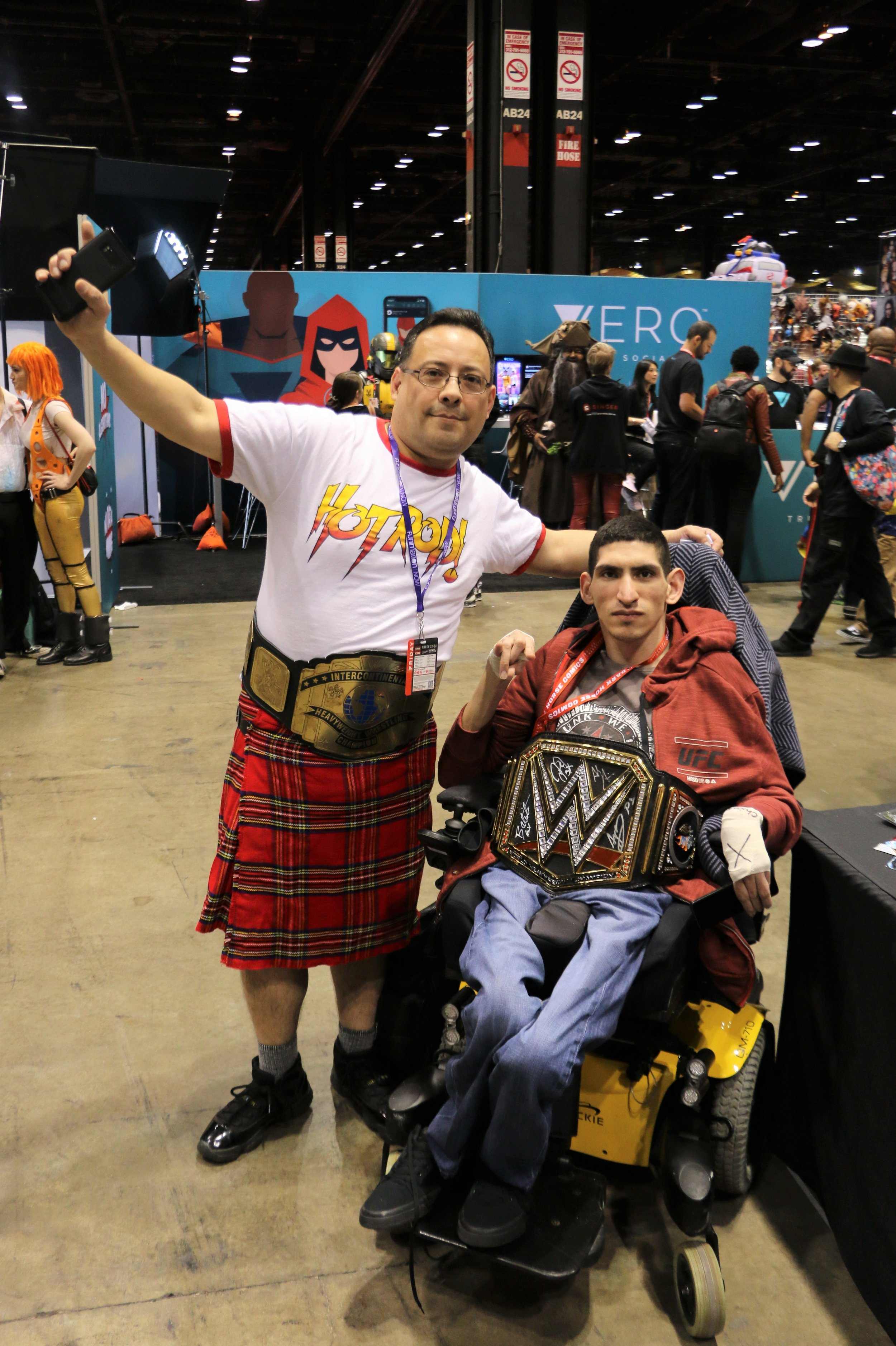 Rowdy Roddy Piper cosplayer poses with Too Sweet Cosplay admin Niko.