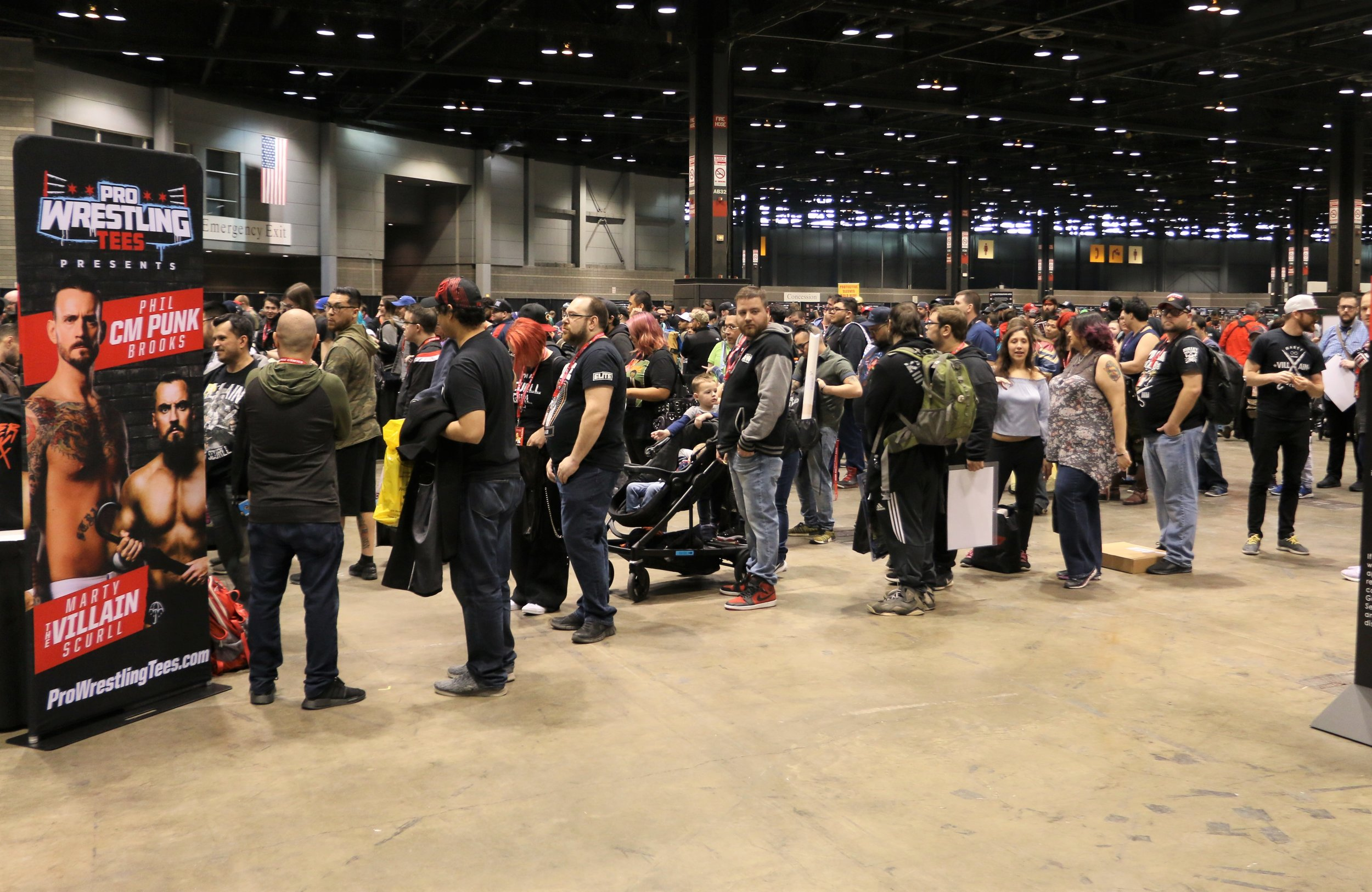 Long lines for Marty Scurll and CM Punk at the Pro Wrestling Tees booth.