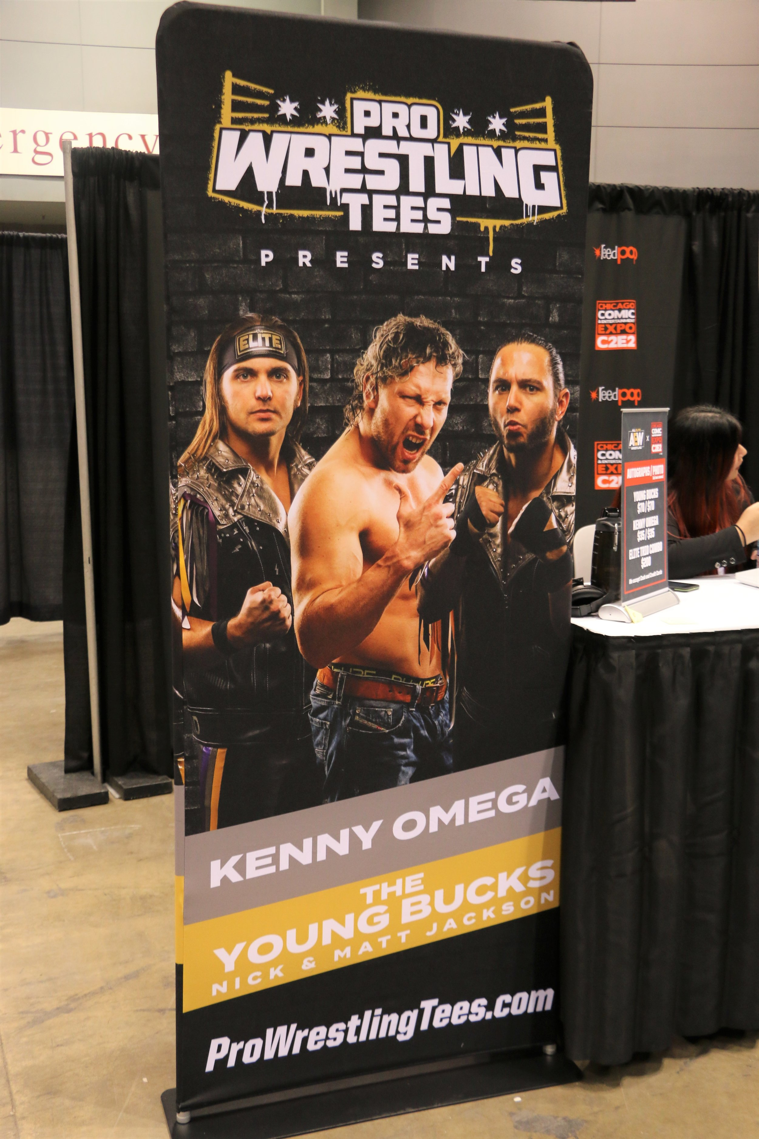 The Young Bucks and Kenny Omega signed plenty of autographs and took many photos with fans.