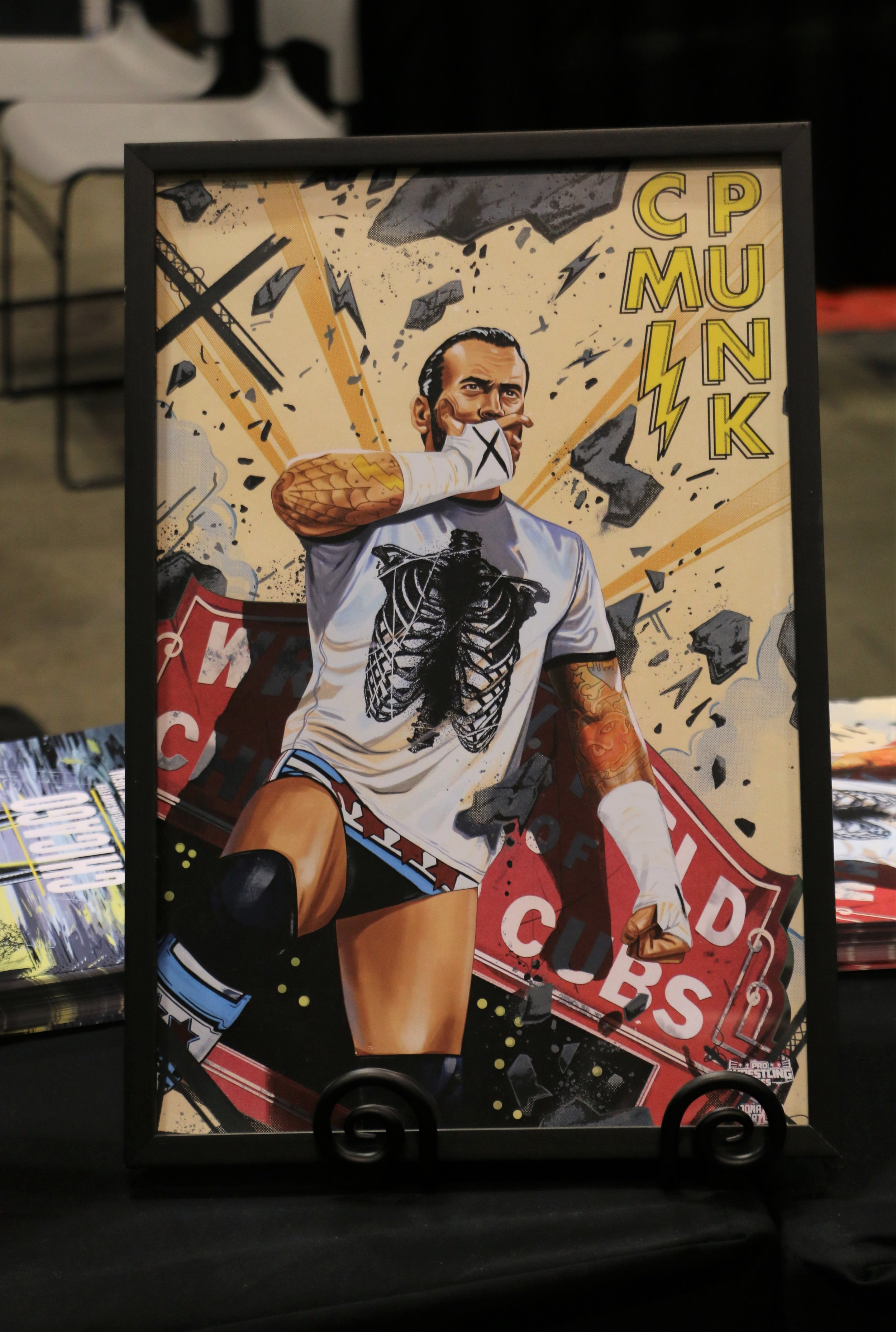 CM Punk portrait at the Pro Wrestling Tees booth.