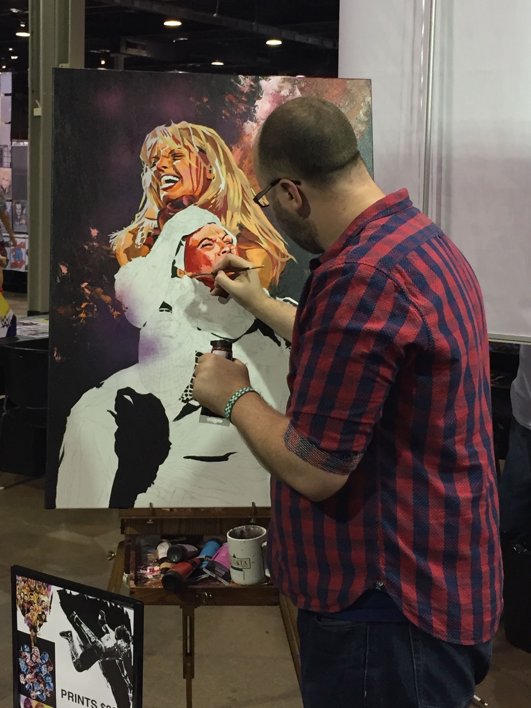 Rob Schamberger works on a piece depicting WWE Hall of Famers Trish Stratus and Lita during Wizard World Chicago in August 2017. (Photo by Mike Pankow)