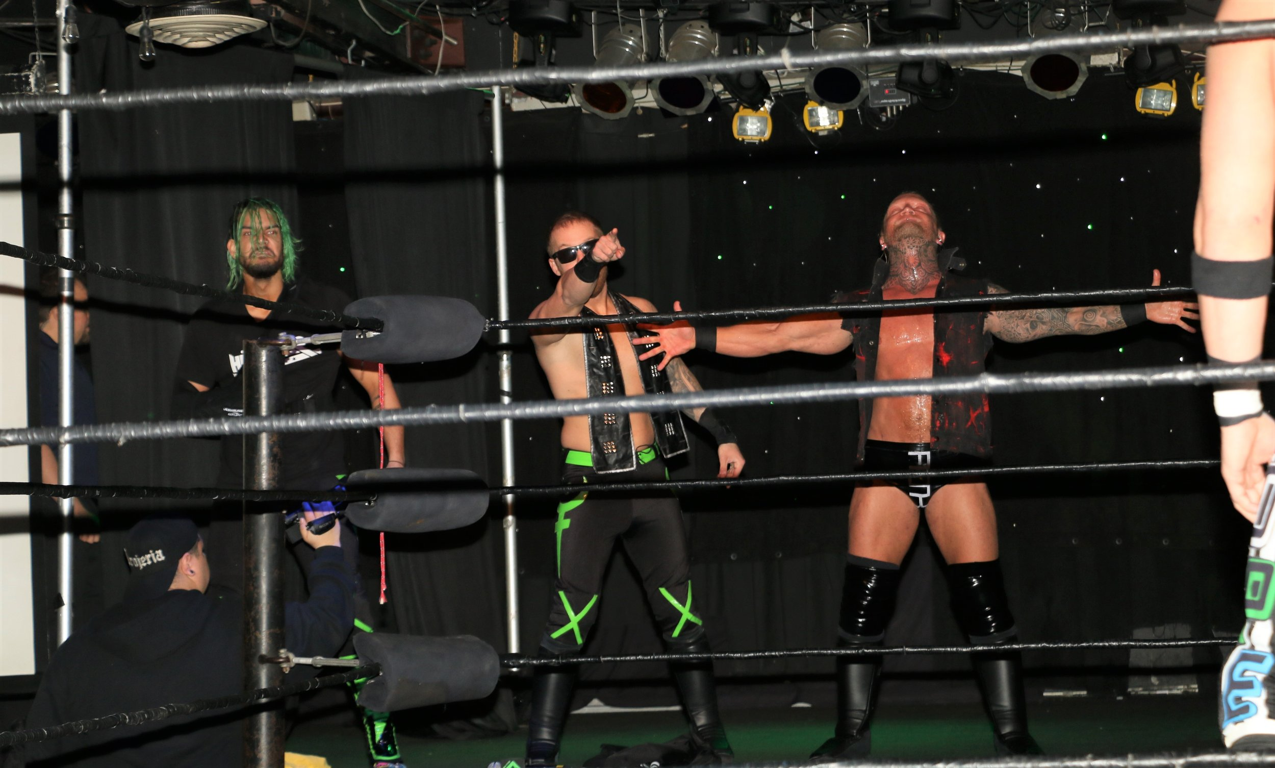 The Blackheart Battalion, Storm Grayson, from left, Jason Hades and Brubaker, enter the ring.