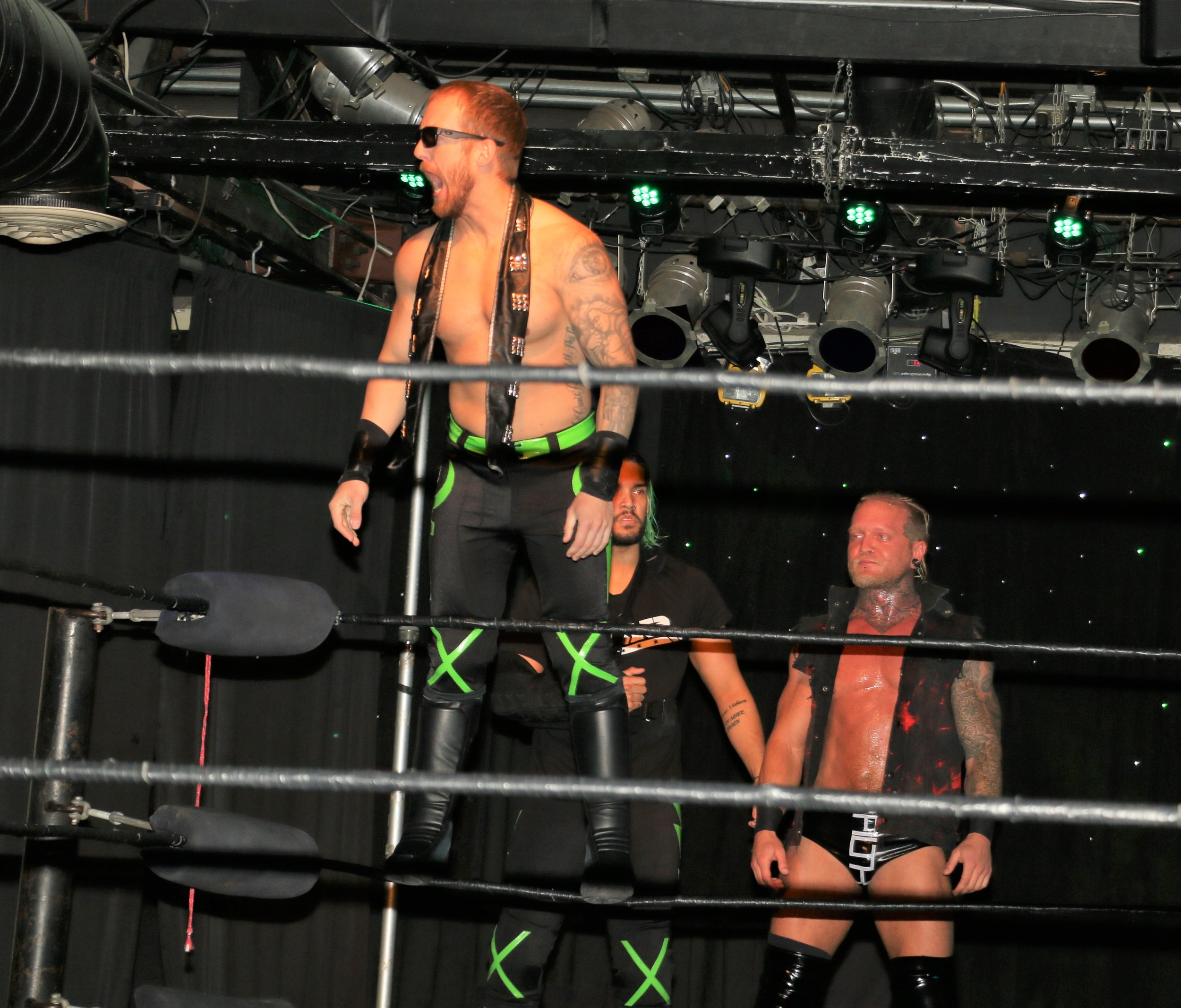 Jason Hades stands on the ropes before the opening tag team match.