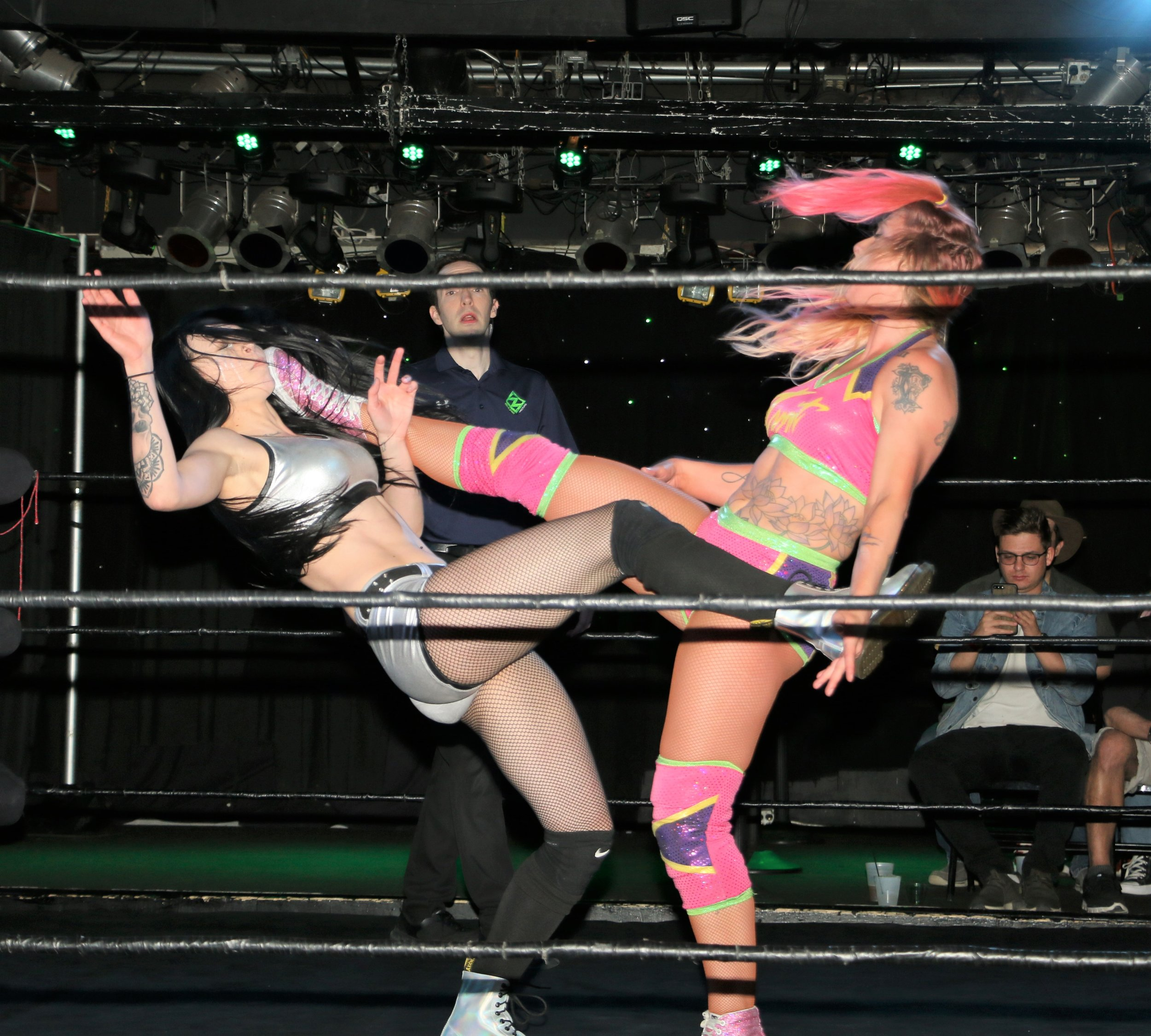Elayna Black, left, and Laynie Luck connect on a double kick, knocking each other down.