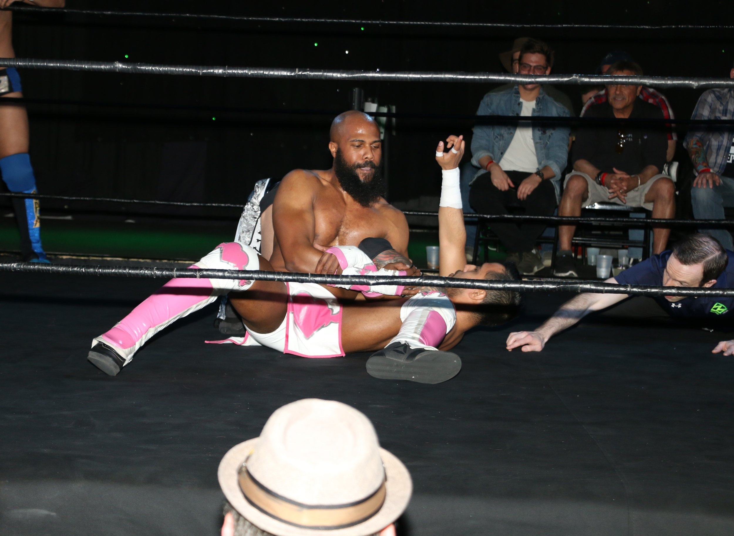 Bryce Benjamin controls Isaias Velazquez during the tag team match.