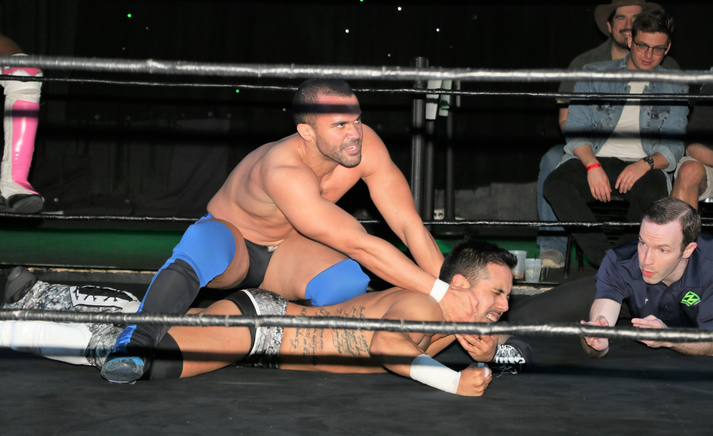 GPA controls Isaias Velazquez during the tag team match.