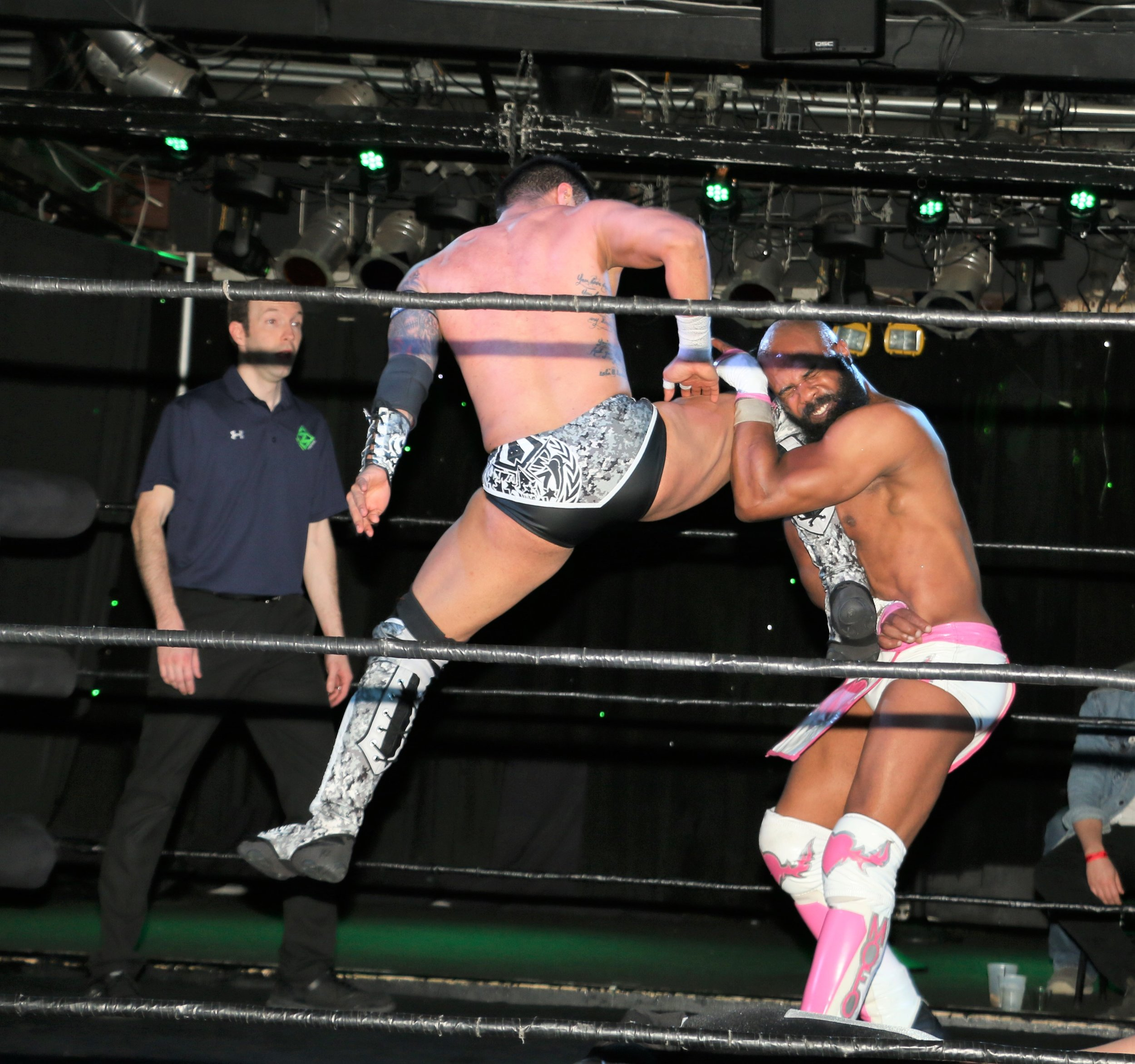 Isaias Velazquez hits a jumping knee on Bryce Benjamin during the tag team match.