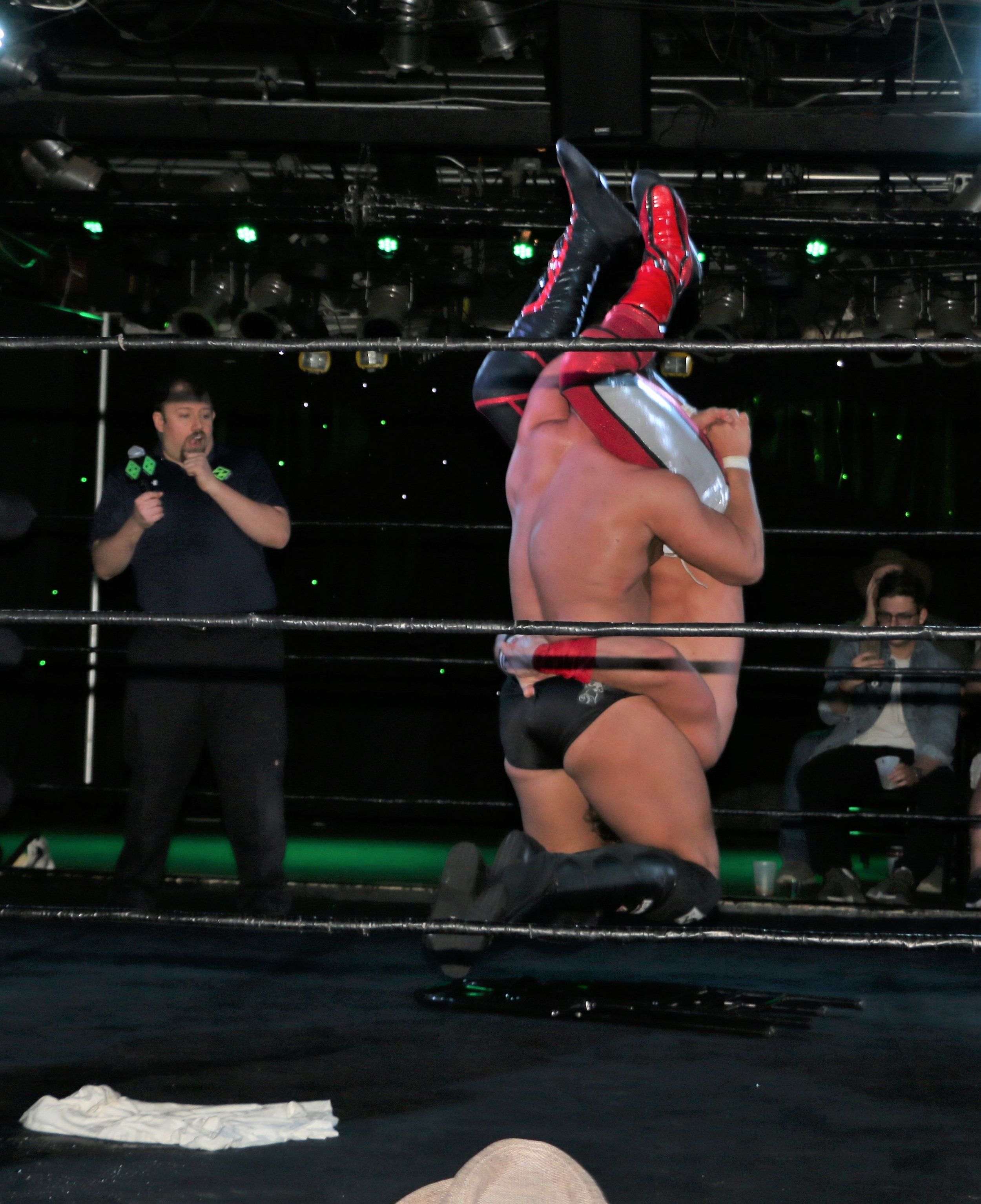 Simon Grimm puts Pat Monix in the tombstone piledriver.