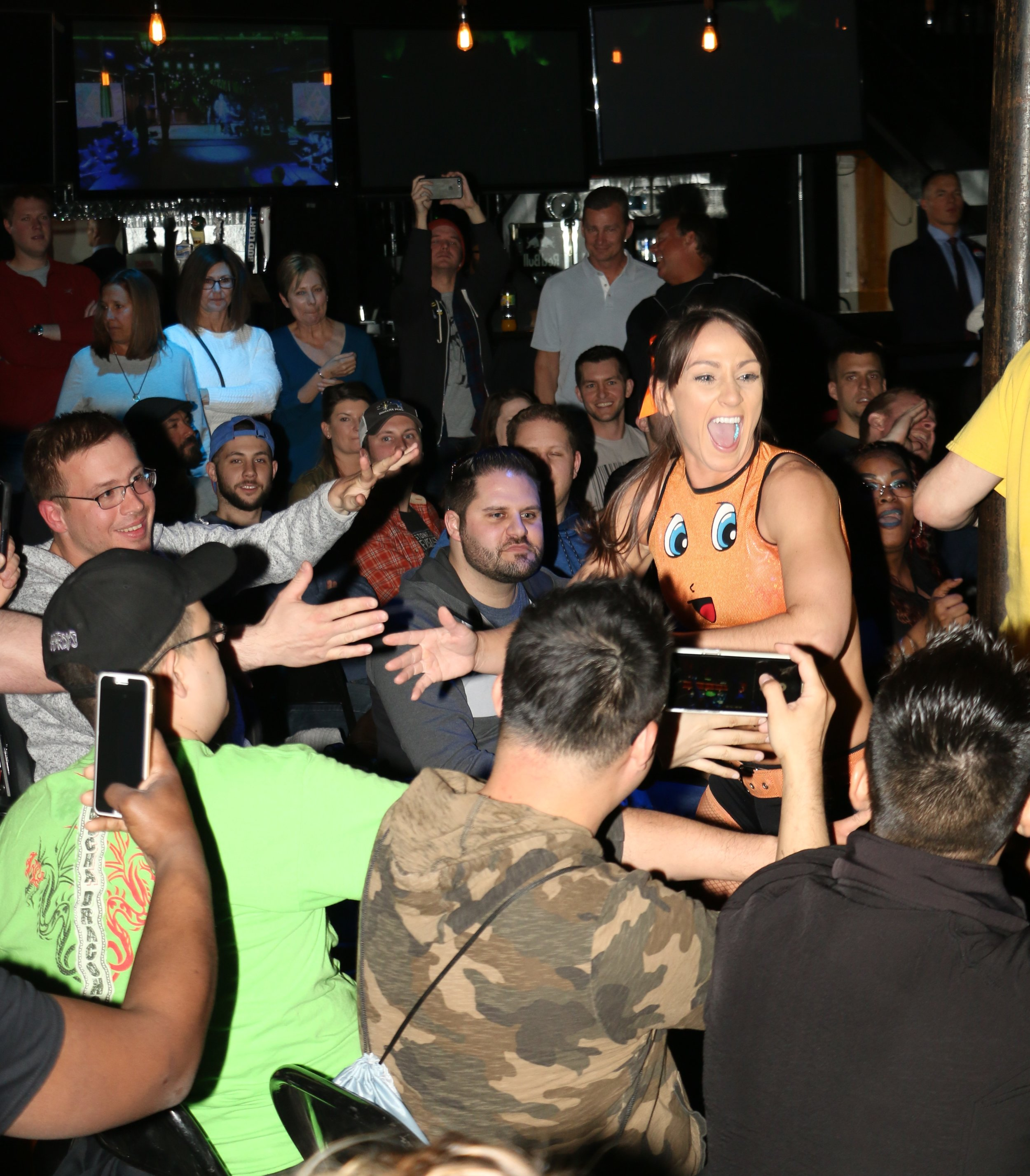 Kylie Rae greets the fans around ringside.