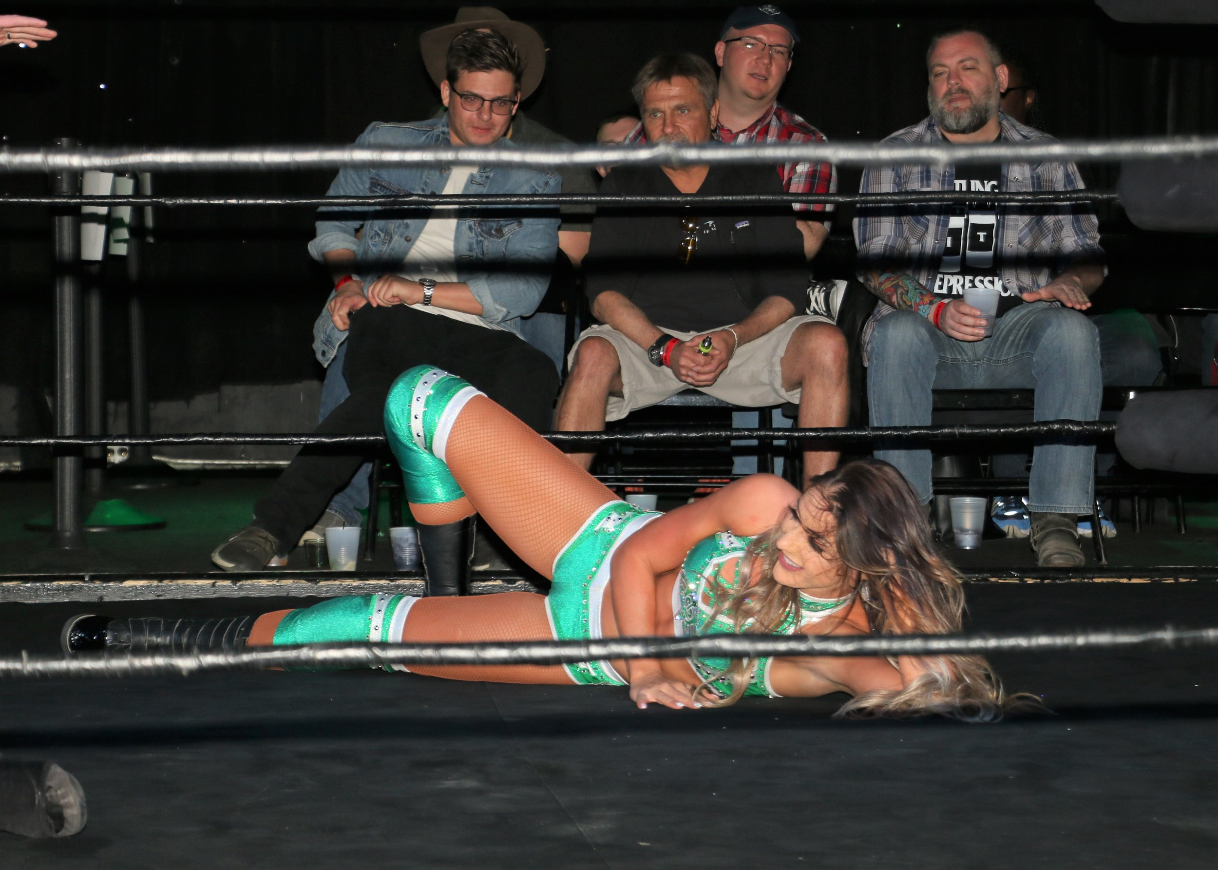 Britt Baker mocks Kylie Rae with one of Kylie's signature poses in the ring.