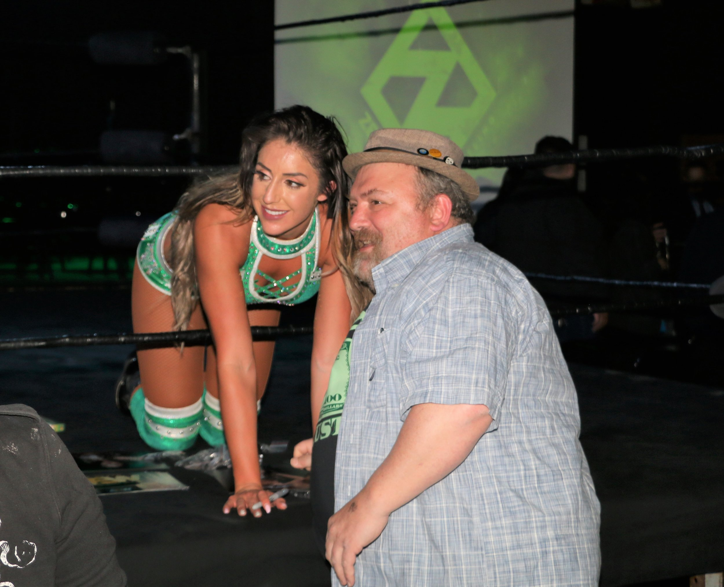 Britt Baker poses with fan during a meet and greet session after the matches.