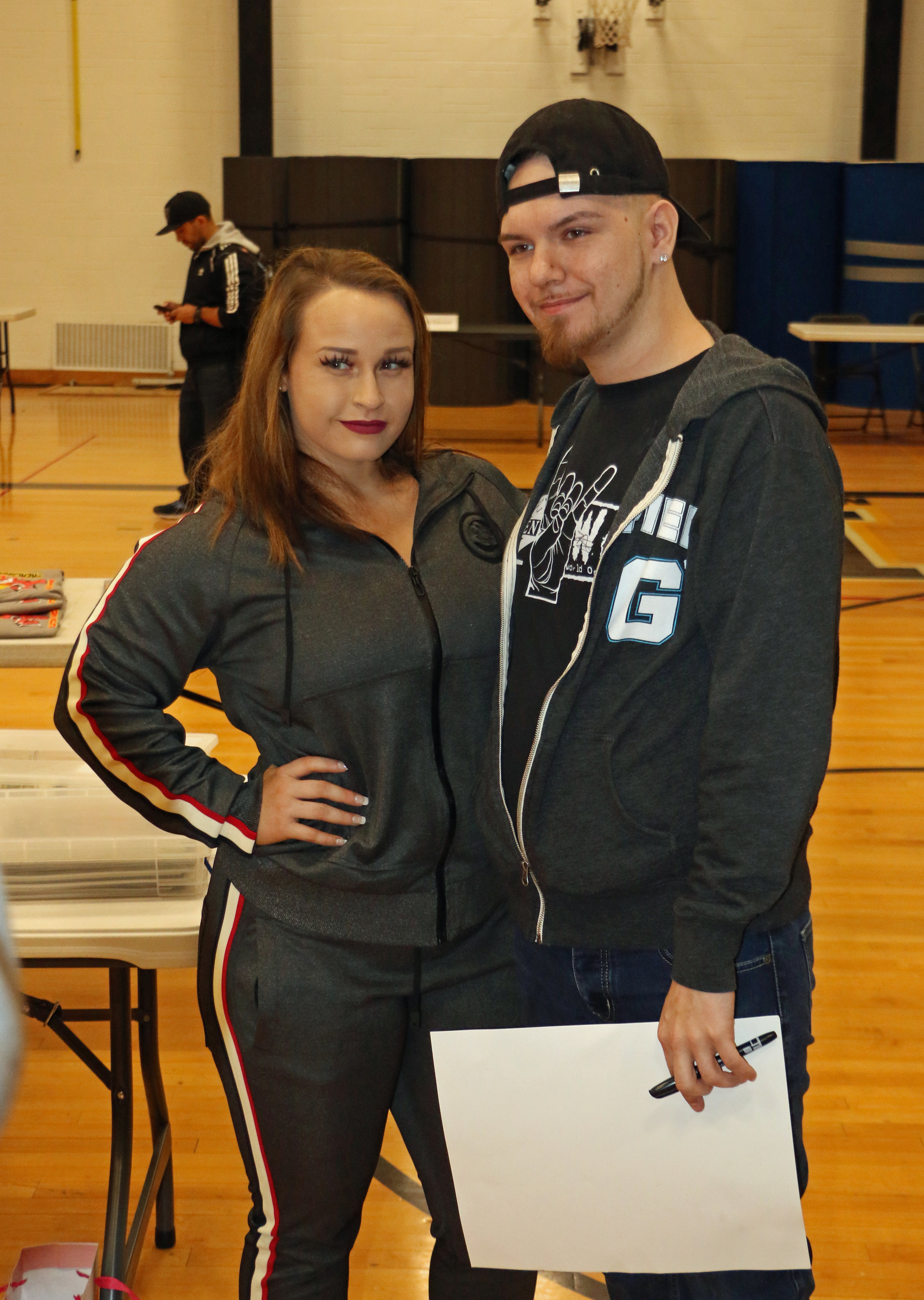 Jordynne Grace takes a picture with a fan during the Warrior Wrestling 5 VIP Fan Fest.