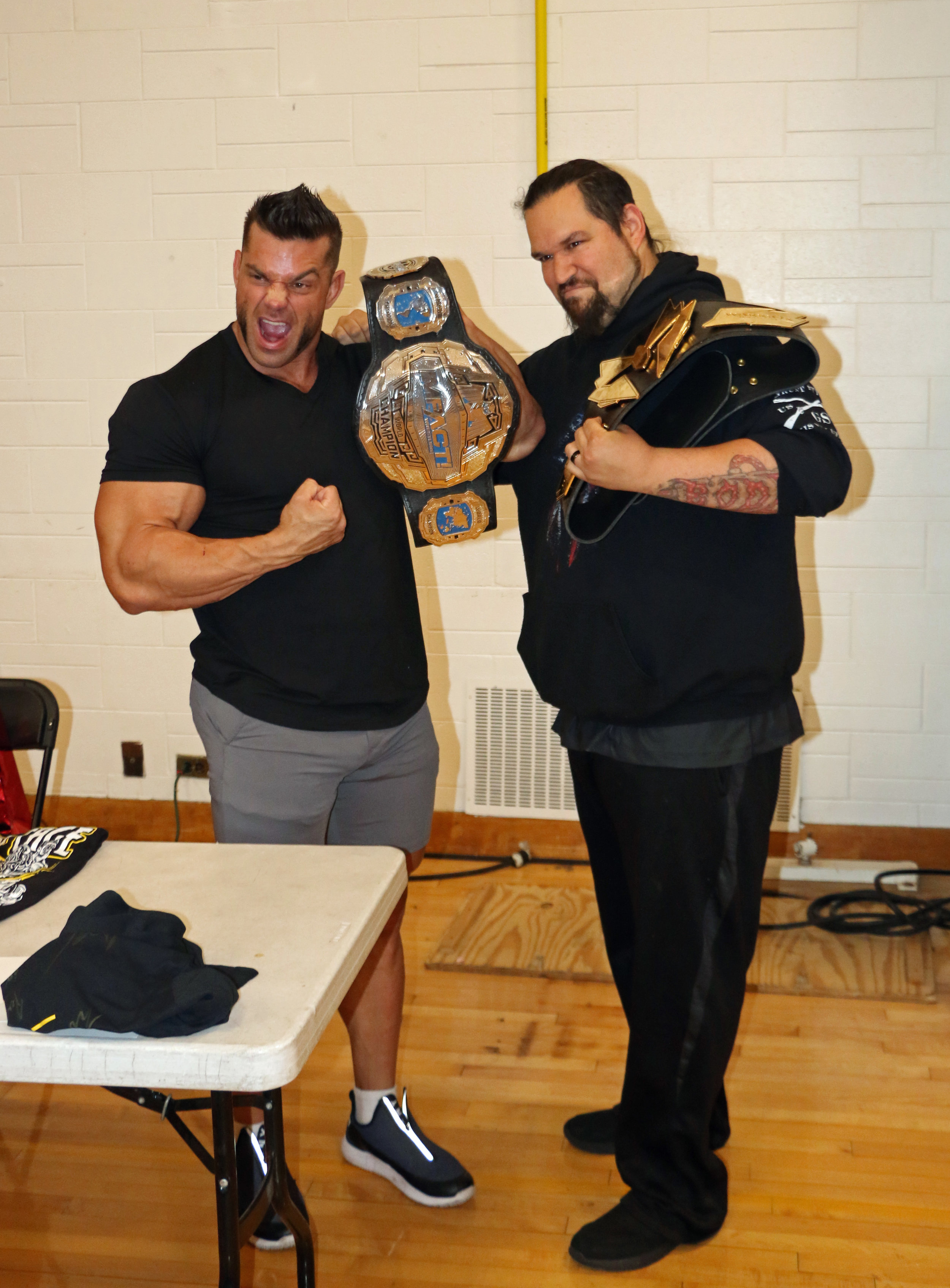 Warrior Wrestling and IMPACT Wrestling Champion Brian Cage poses with a fan during the Warrior Wrestling 5 VIP Fan Fest.