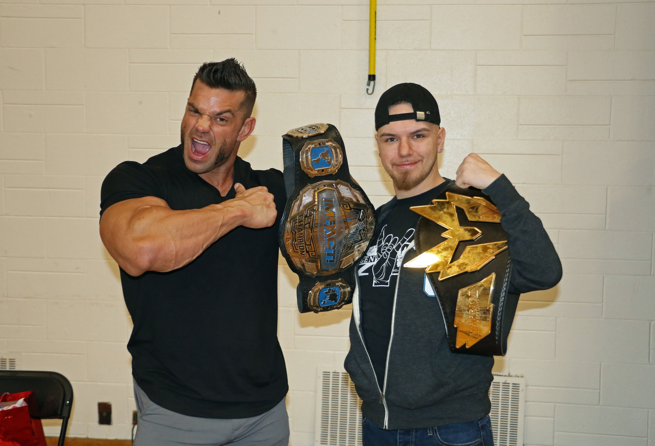 #Brian2Belts: Brian Cage poses with a fan during the Warrior Wrestling 5 VIP Fan Fest.