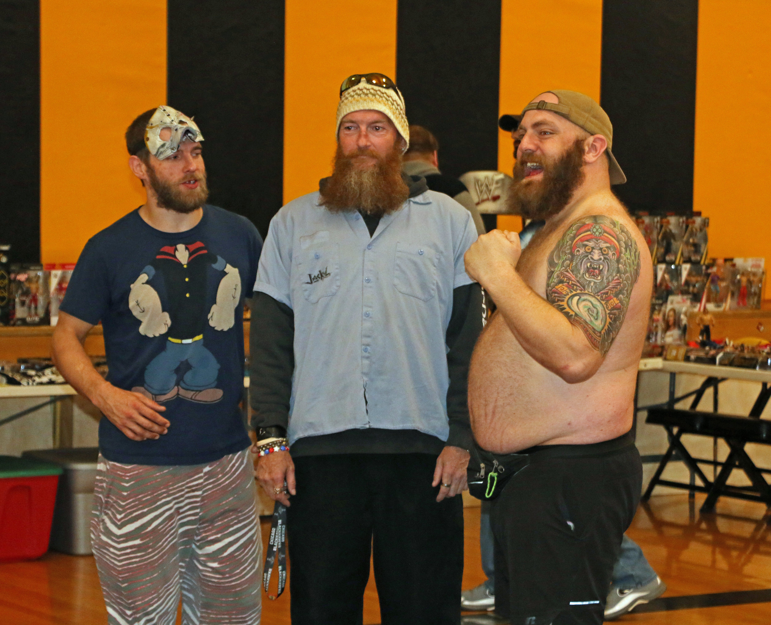 Rob Killjoy, left, and Coach Mikey, right, of the Ugly Duckings pose with a fan during the Warrior Wrestling 5 VIP Fan Fest.