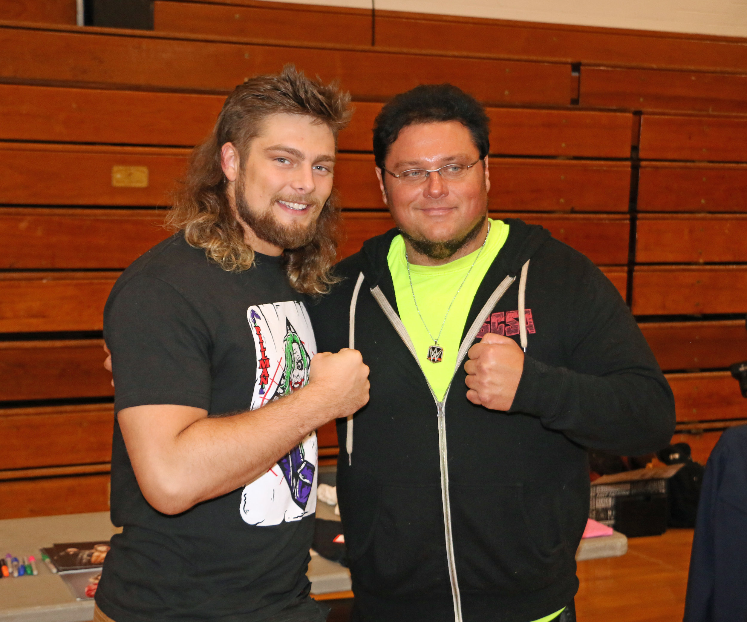 Brian Pillman Jr. poses with a fan during the Warrior Wrestling 5 VIP Fan Fest.