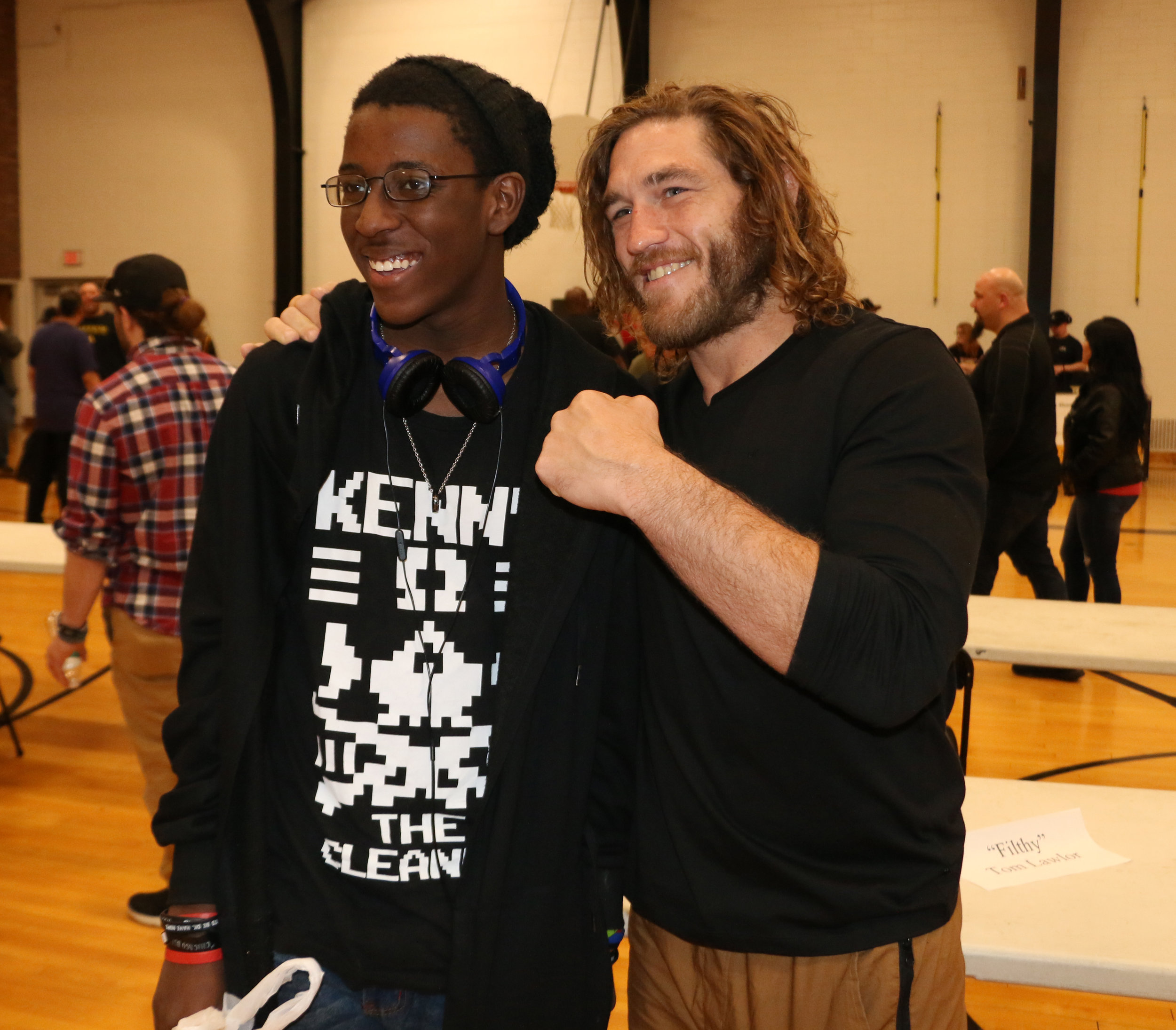 "A fan poses with MLW Champion ""Filthy"" Tom Lawlor during the Warrior Wrestling 5 VIP Fan Fest."