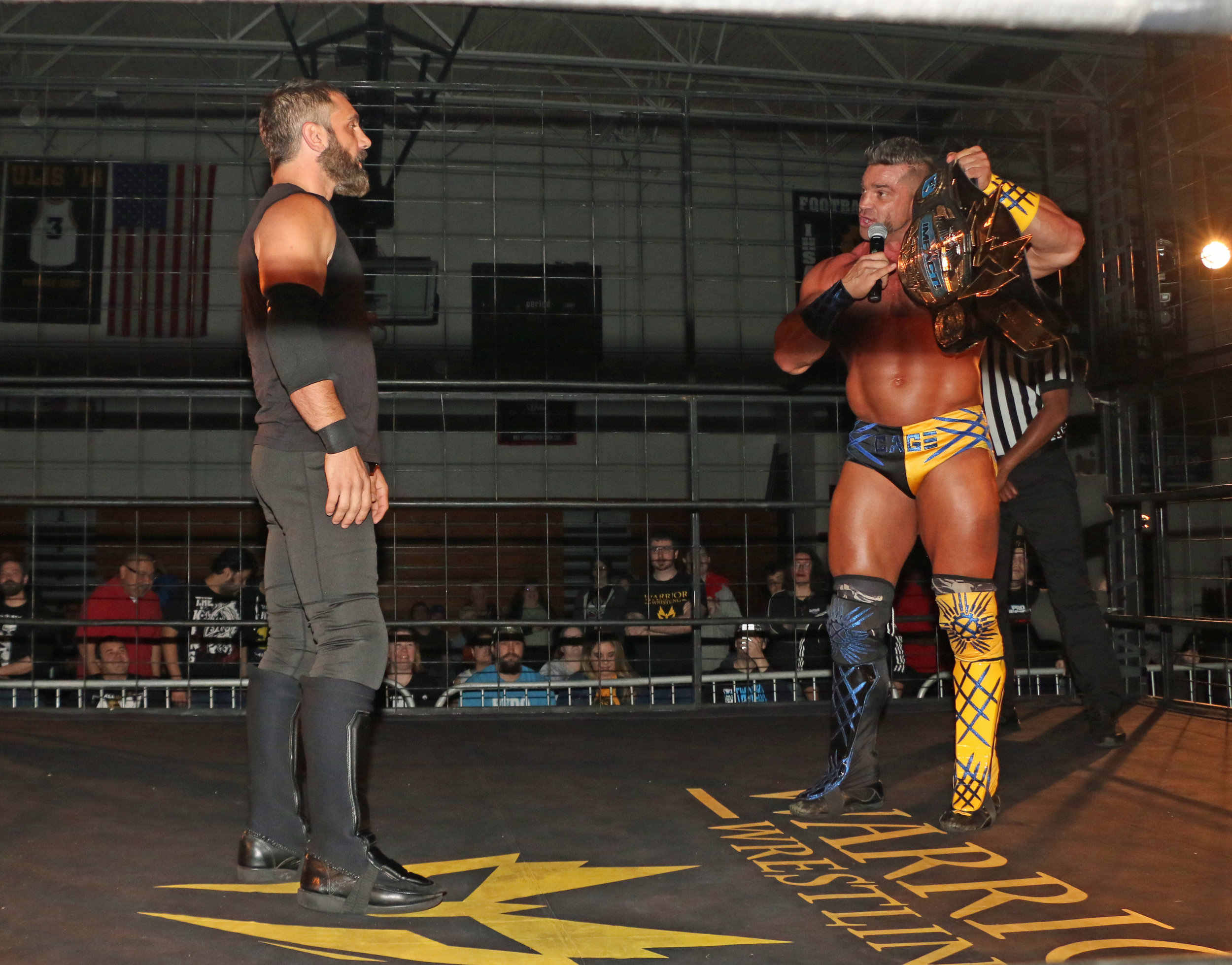 Brian Cage, right, was willing to play along with Austin Aries and defend his title against him and Wardlow in the cage.