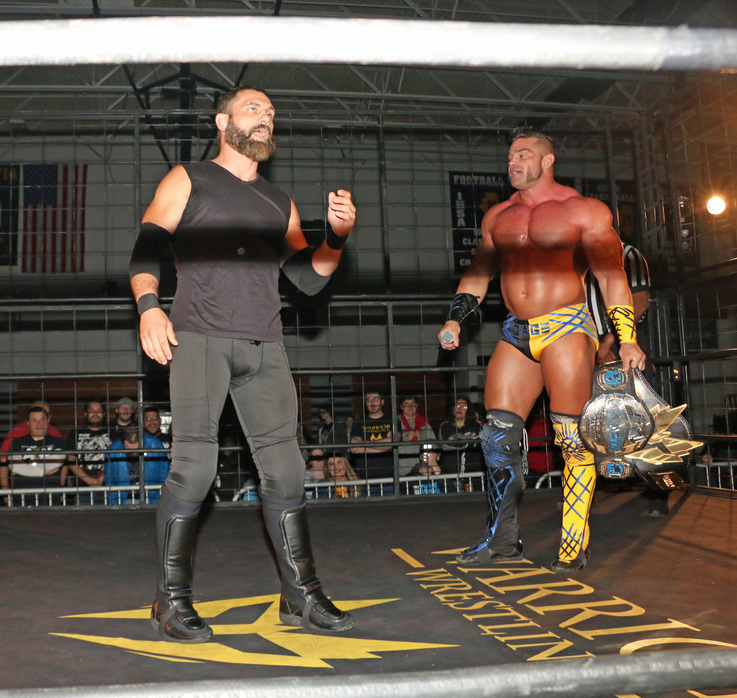 Austin Aries, left, wanted a shot at Brian Cage's Warrior Wrestling Championship.