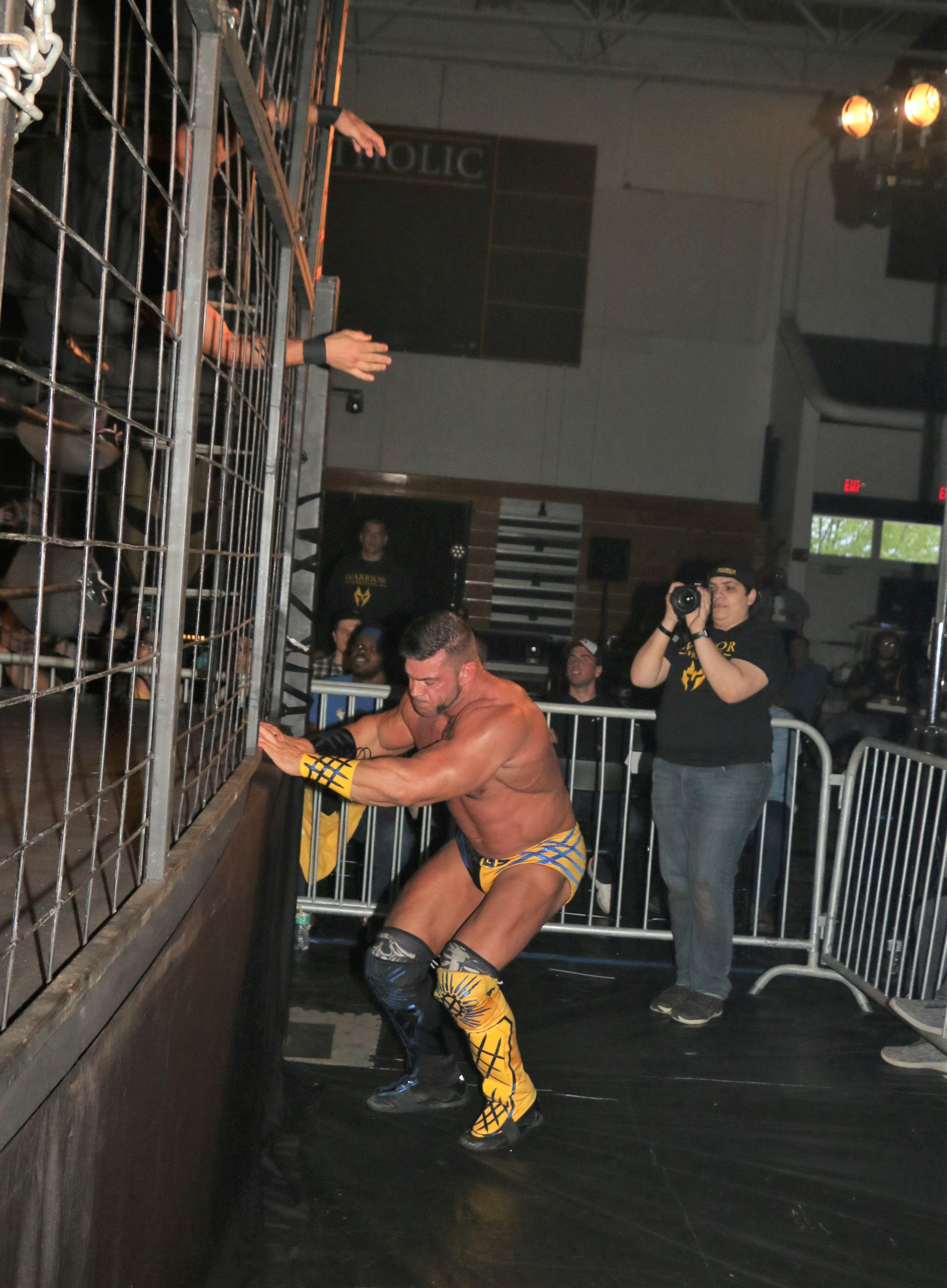 Brian Cage hits the floor to earn the victory and successfully defend his Warrior Wrestling Championship.