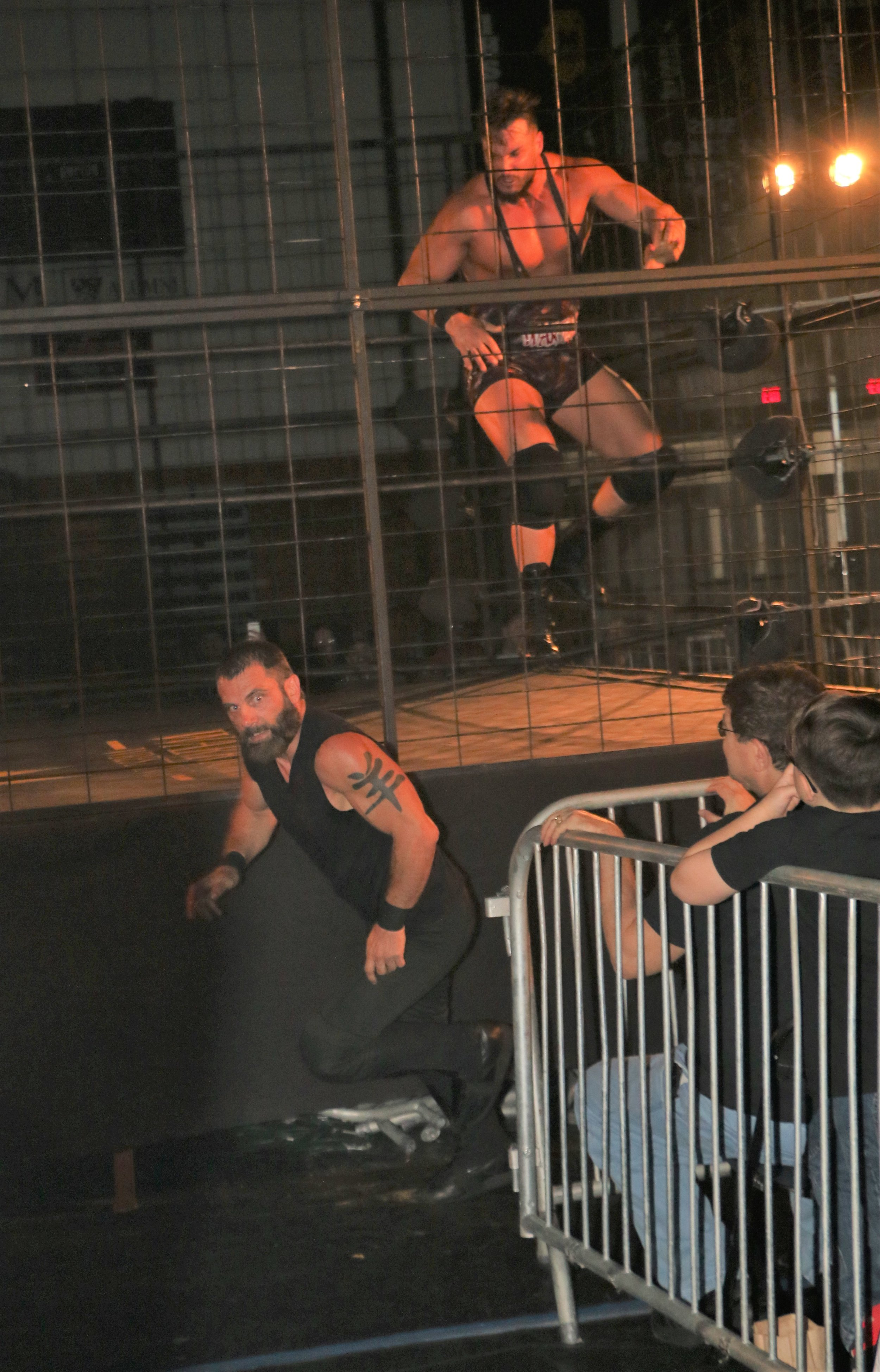 Austin Aries scurries away from Wardlow after the three-way cage match.