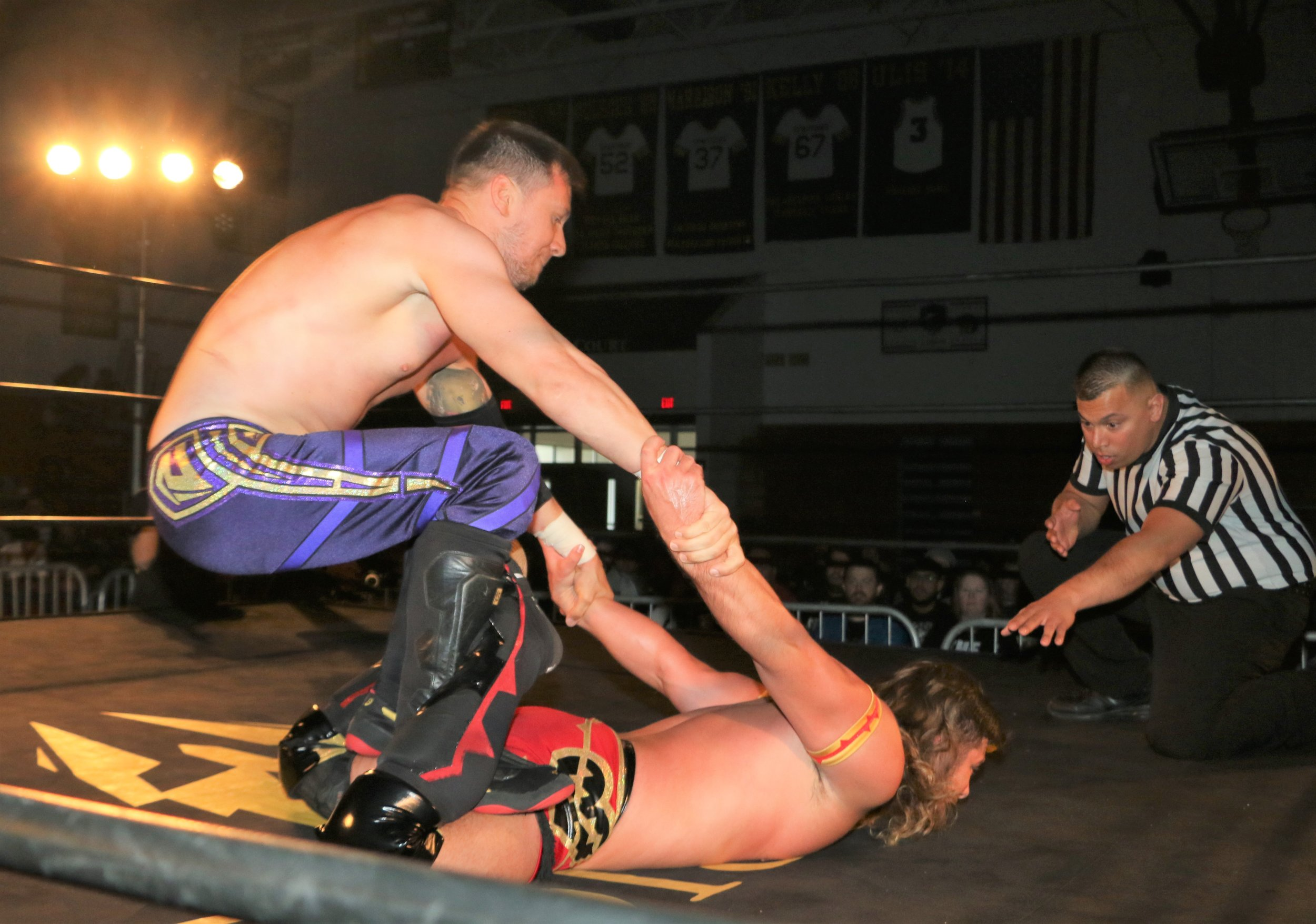 "Robert ""Ego"" Anthony puts Brian Pillman Jr. in a surfboard."