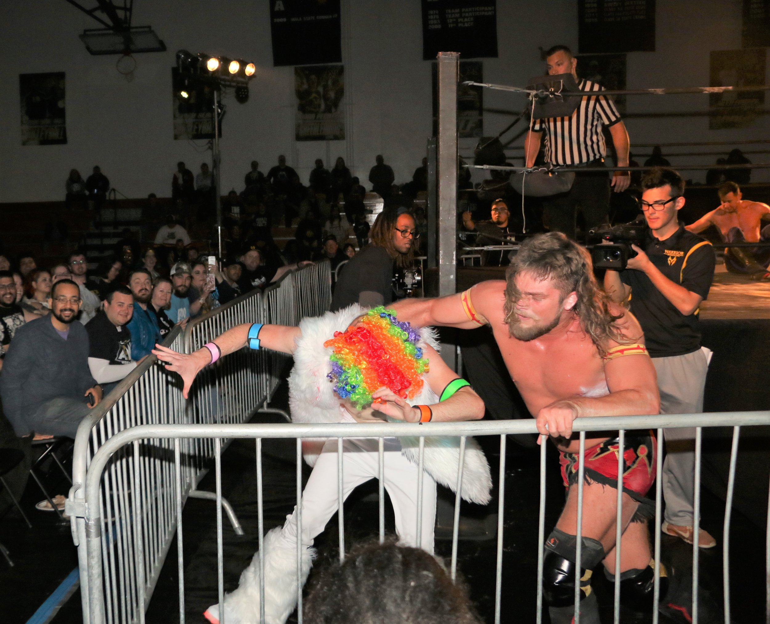 "After beating Robert ""Ego"" Anthony, Brian Pillman Jr. got five minutes with Frank the Clown and here, he throws Frank into the ringside barrier."