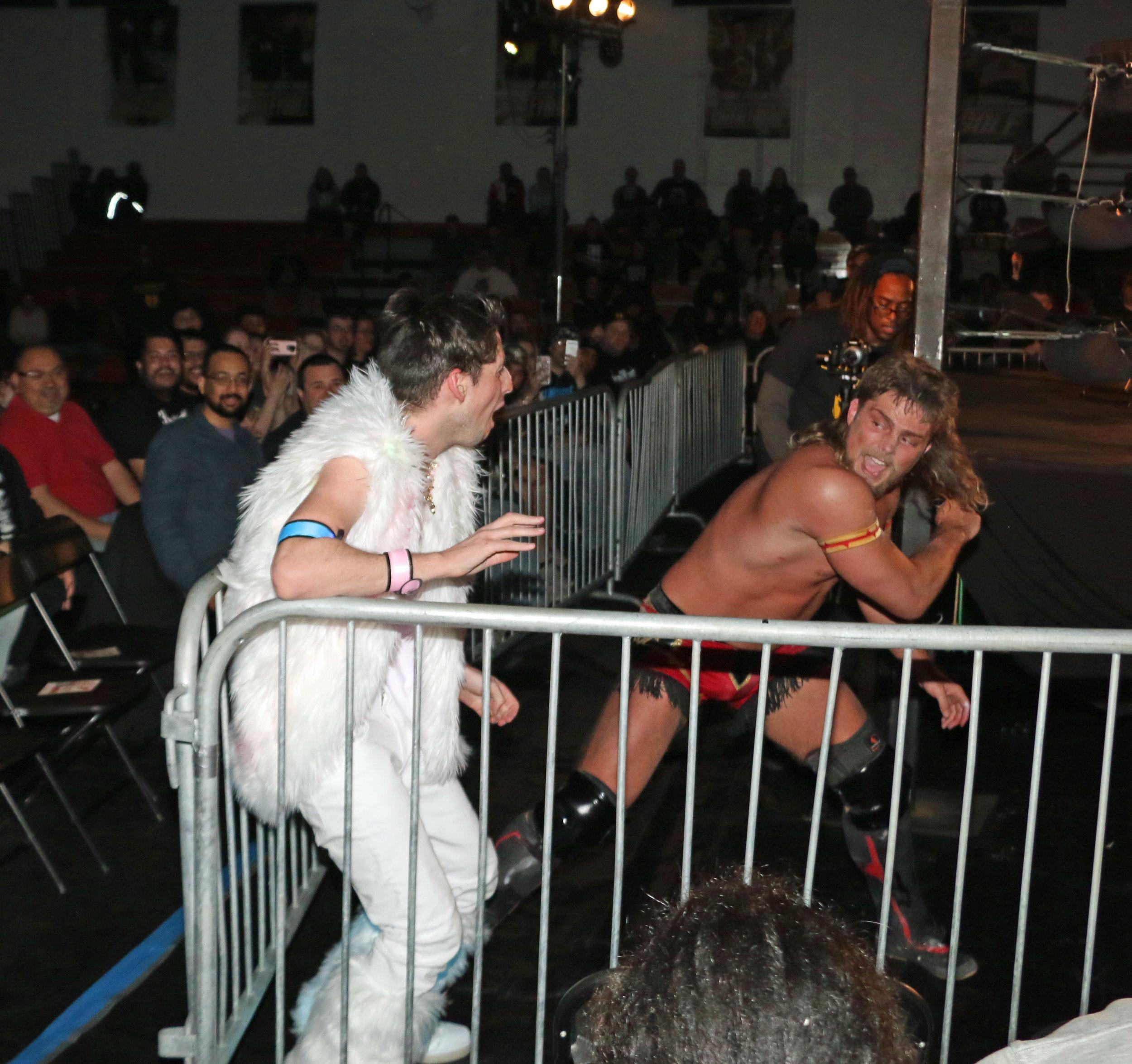 Brian Pillman Jr. unleashes a chop to Frank the Clown.