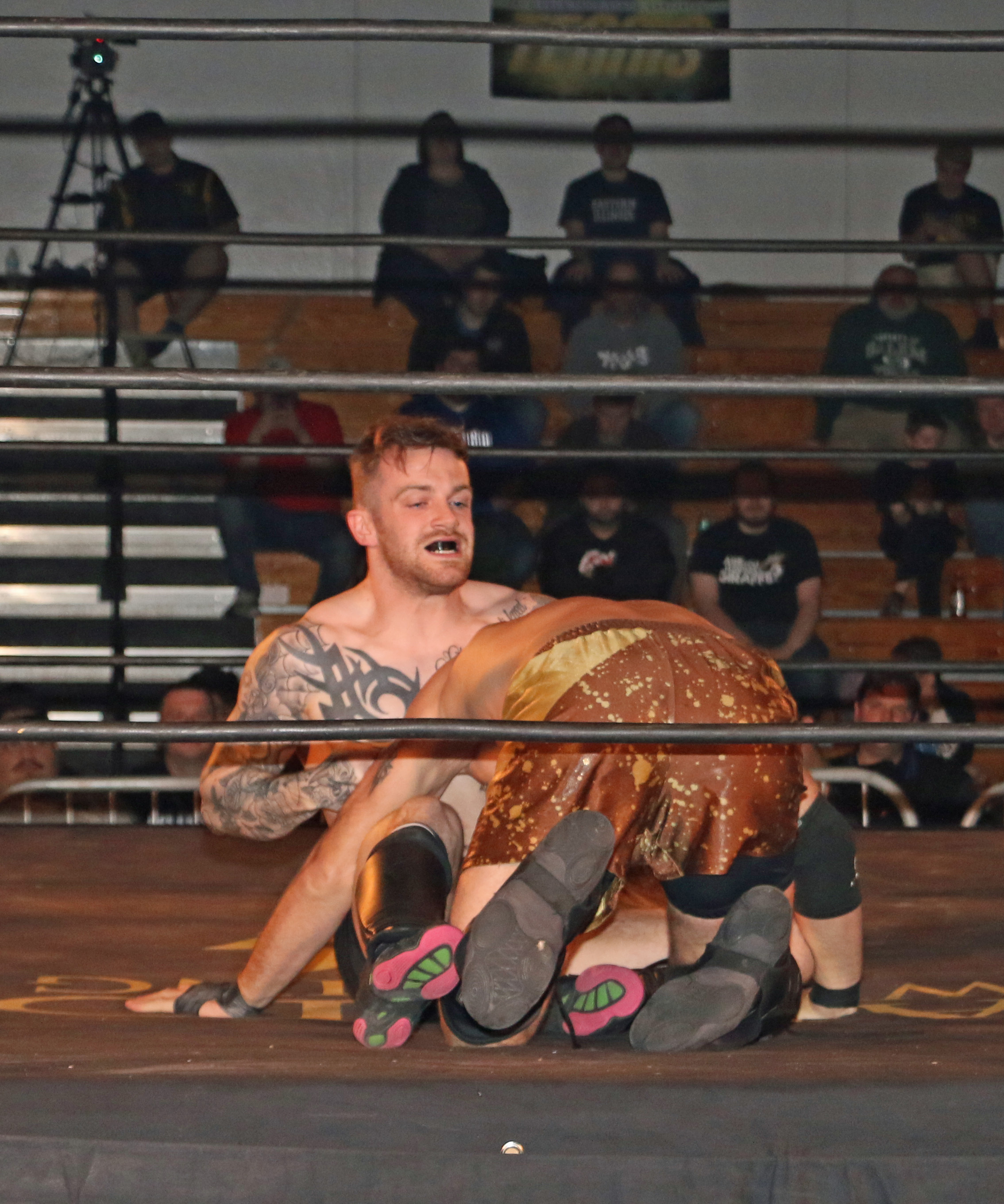 Chris Ridgeway controls Tom Lawlor in a match filled with submission holds and strong-style strikes.