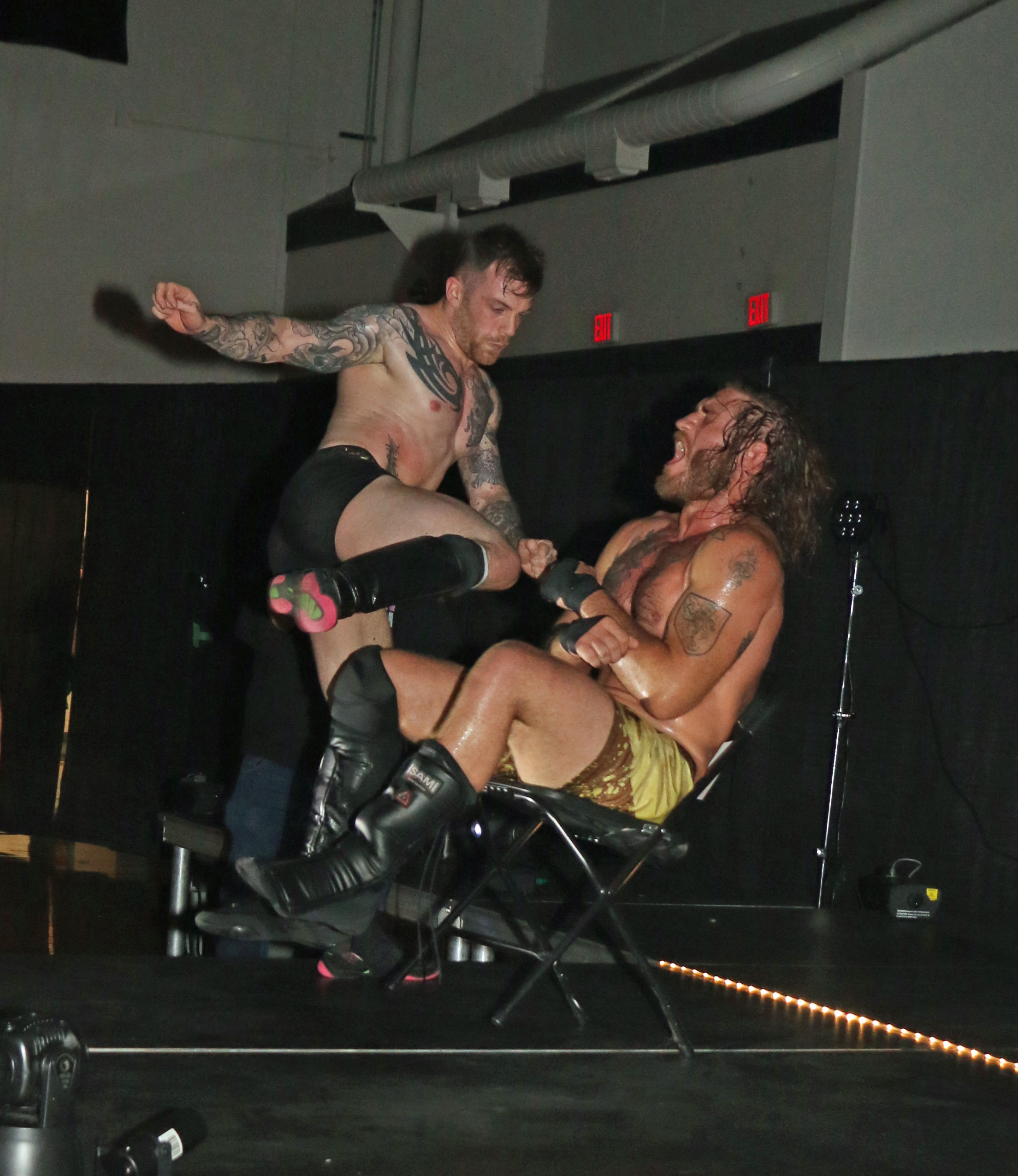 Chris Ridgeway hits a running knee to Tom Lawlor on the entrance stage.