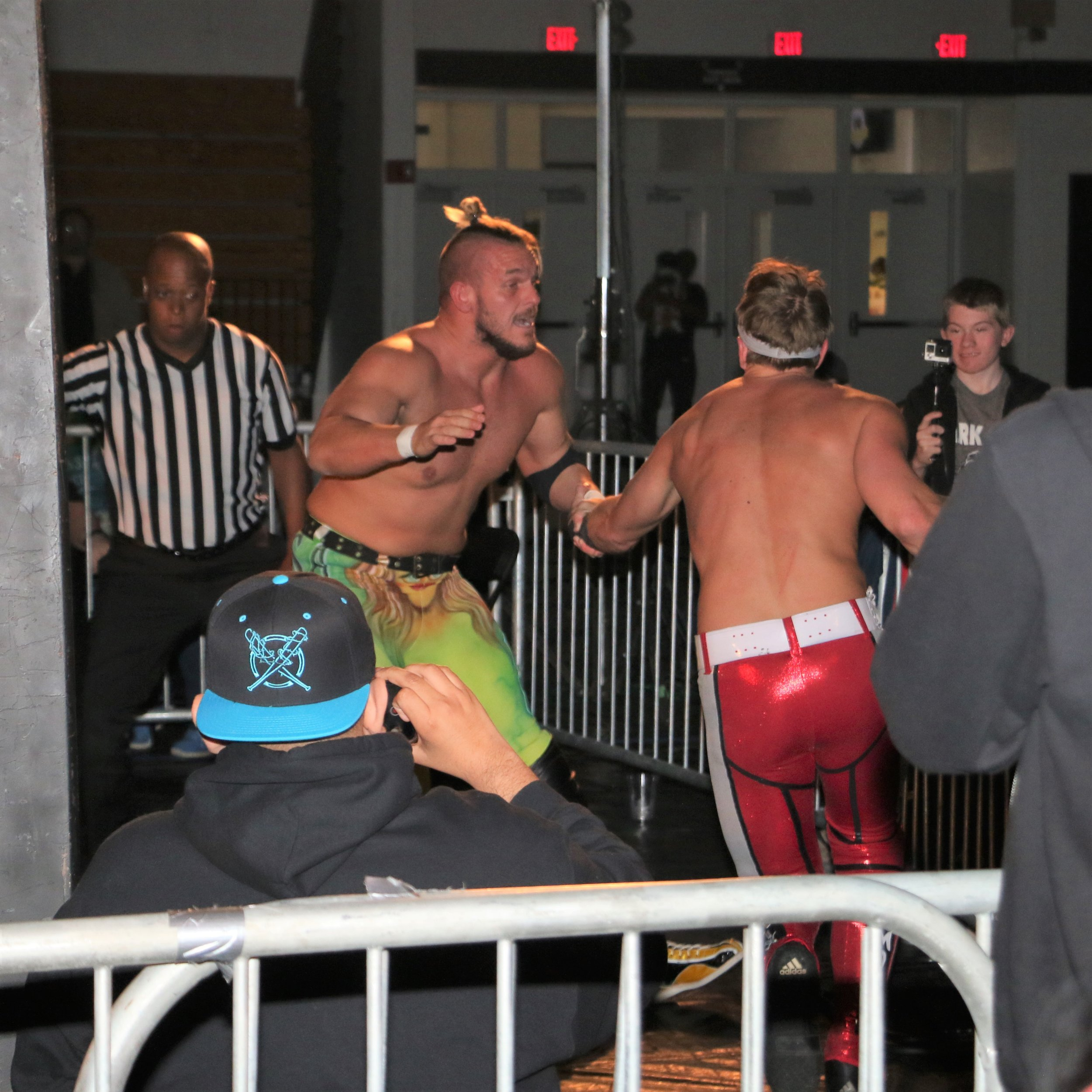 The No DQ match quickly escalated into a war outisde the ring as Sam Adonis whips Pat Monix into the barrier.