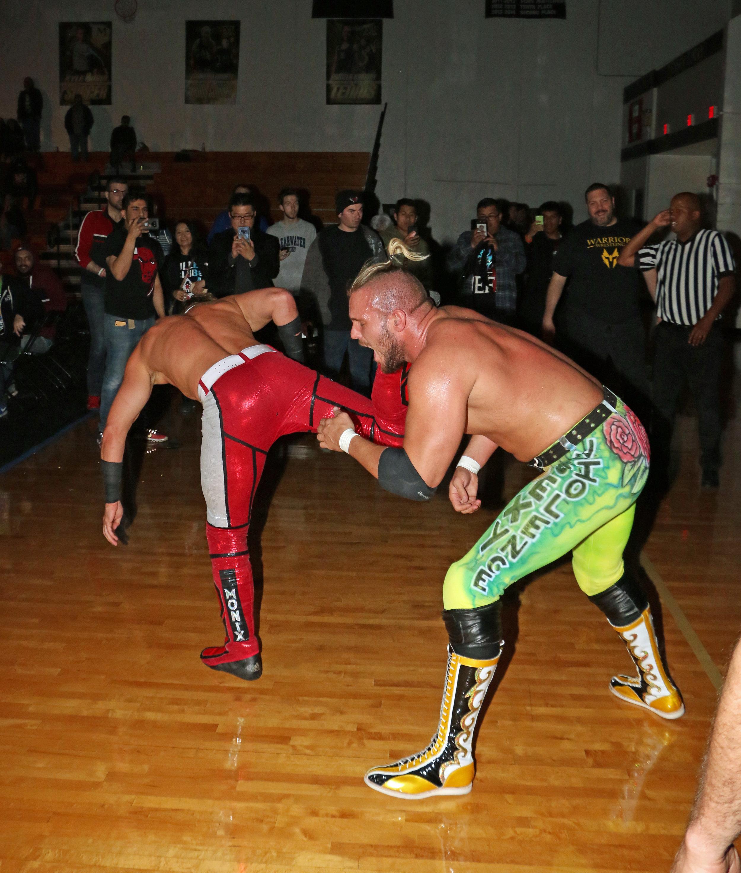Pat Monix kicks Sam Adonis on the outside.