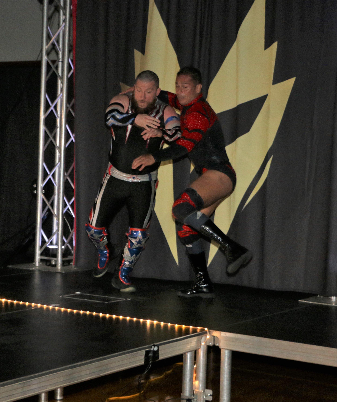 Volador Jr. throws Gringo Loco off the entrance stage.