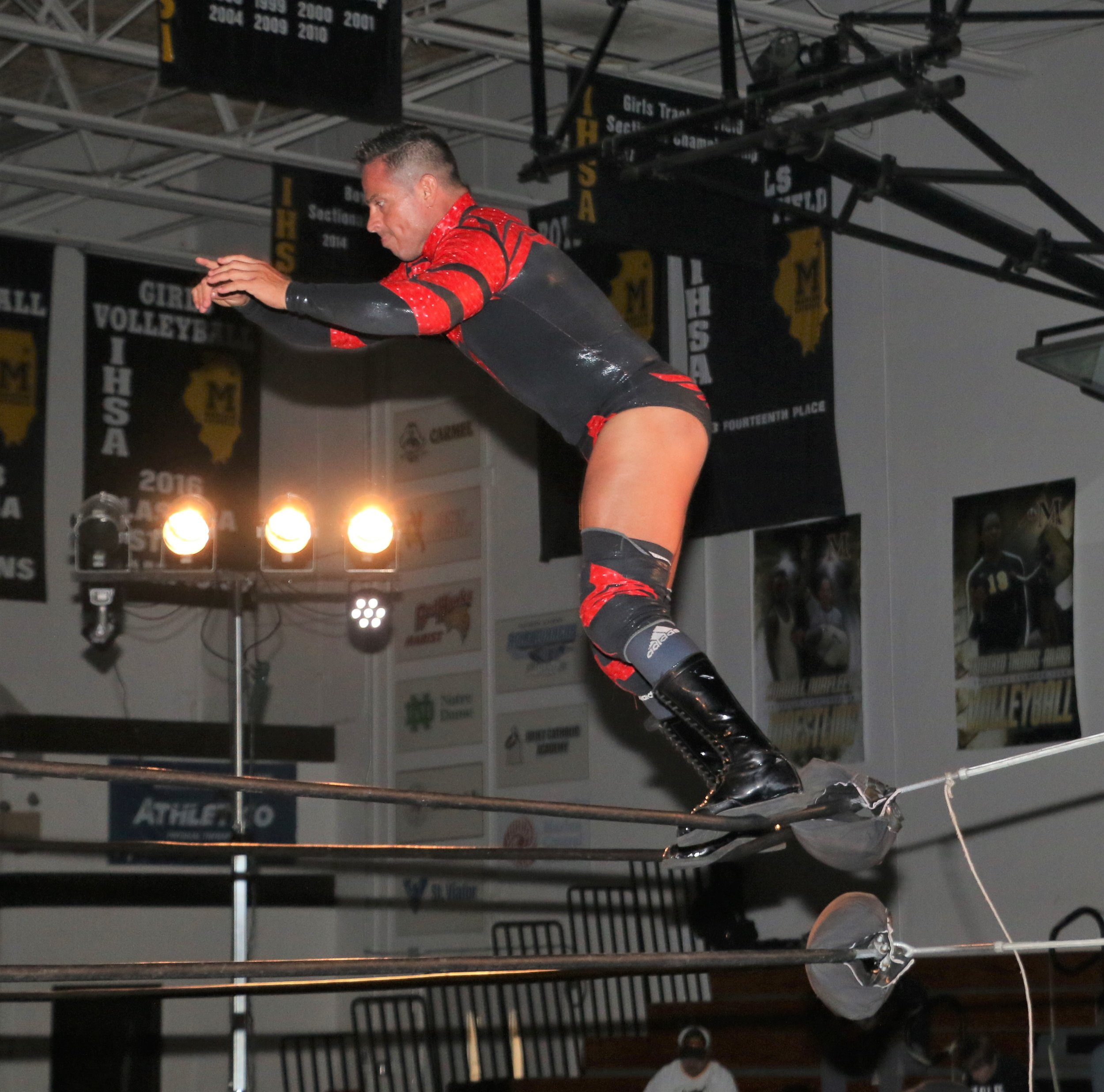Volador Jr. leaps off the top rope.