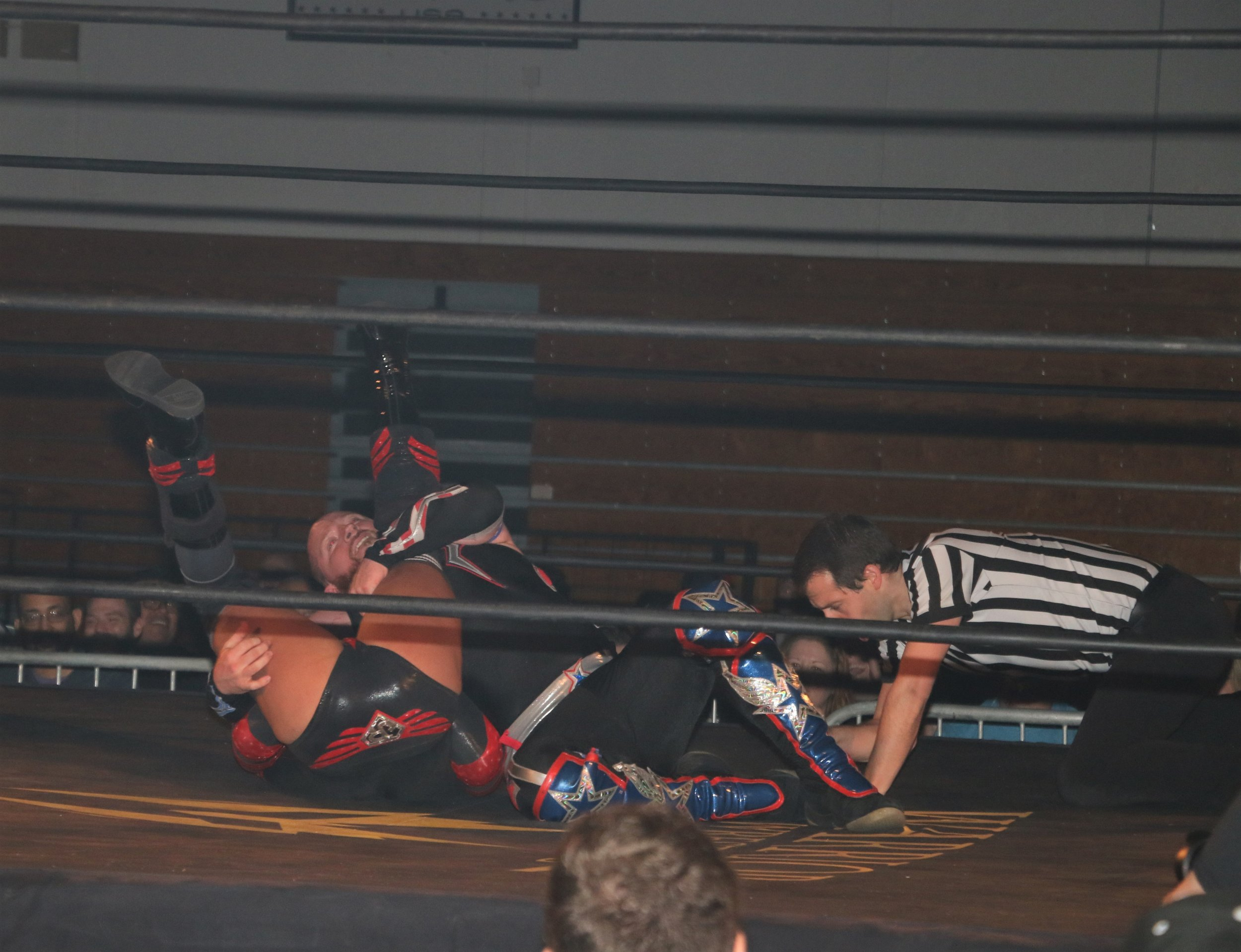 Referee Nate Speckman makes the count as Gringo Loco attmpts to pin Volador Jr.