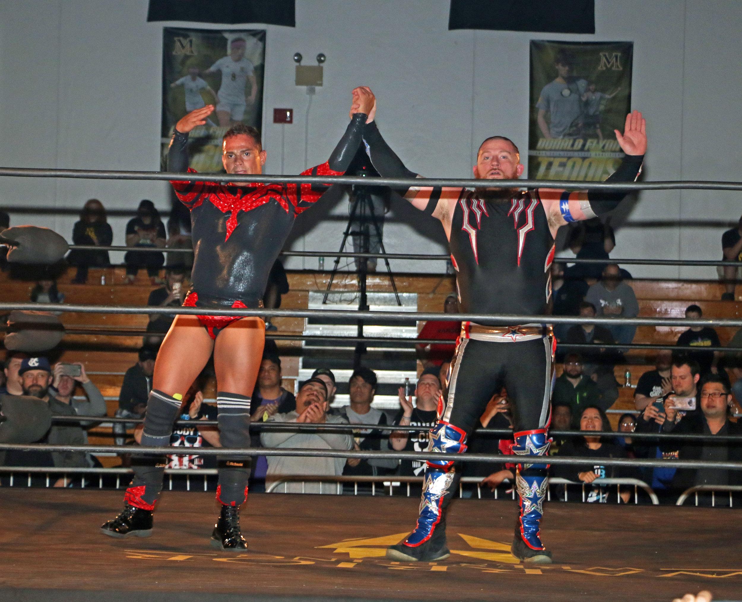 Volador Jr. shows respect for Gringo Loco after the match.