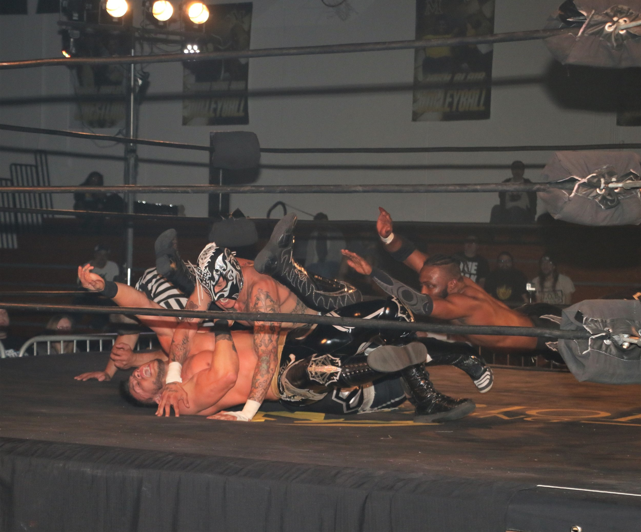 Fenix makes the cover on Daga as Kotto Brazil tries to break up the pinfall.