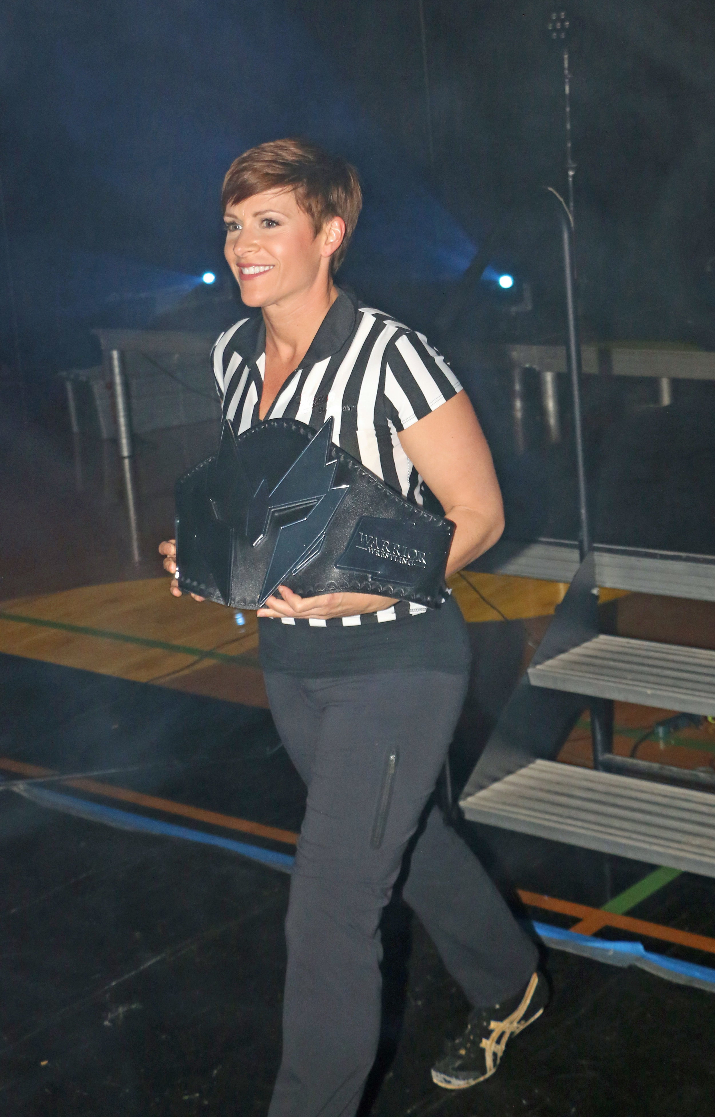 Special guest referee Molly Holly walks out with the brand-new Warrior Wrestling Women's Championship.