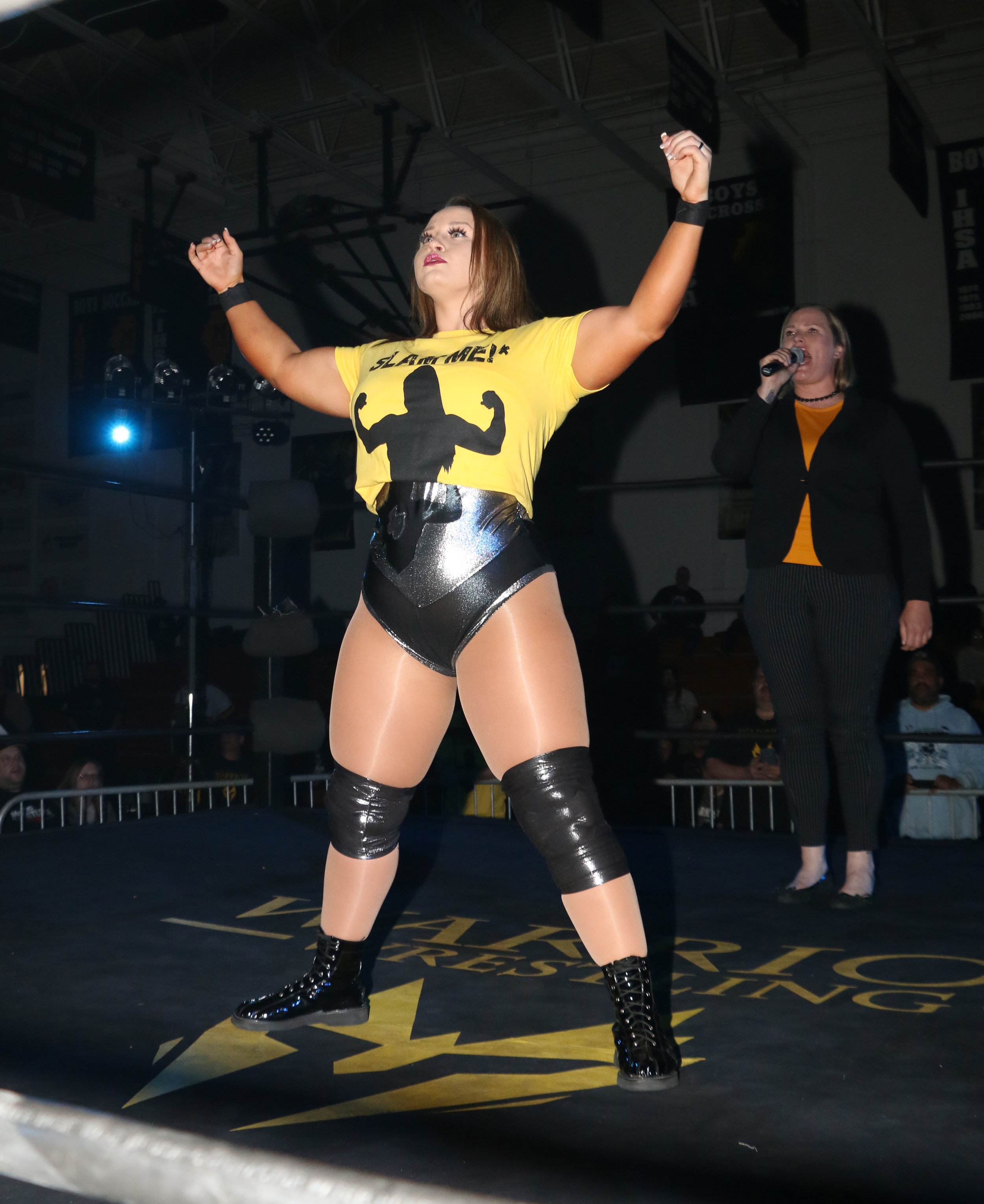 Jordynne Grace poses as Val Capone, background, introduces her for the main event.
