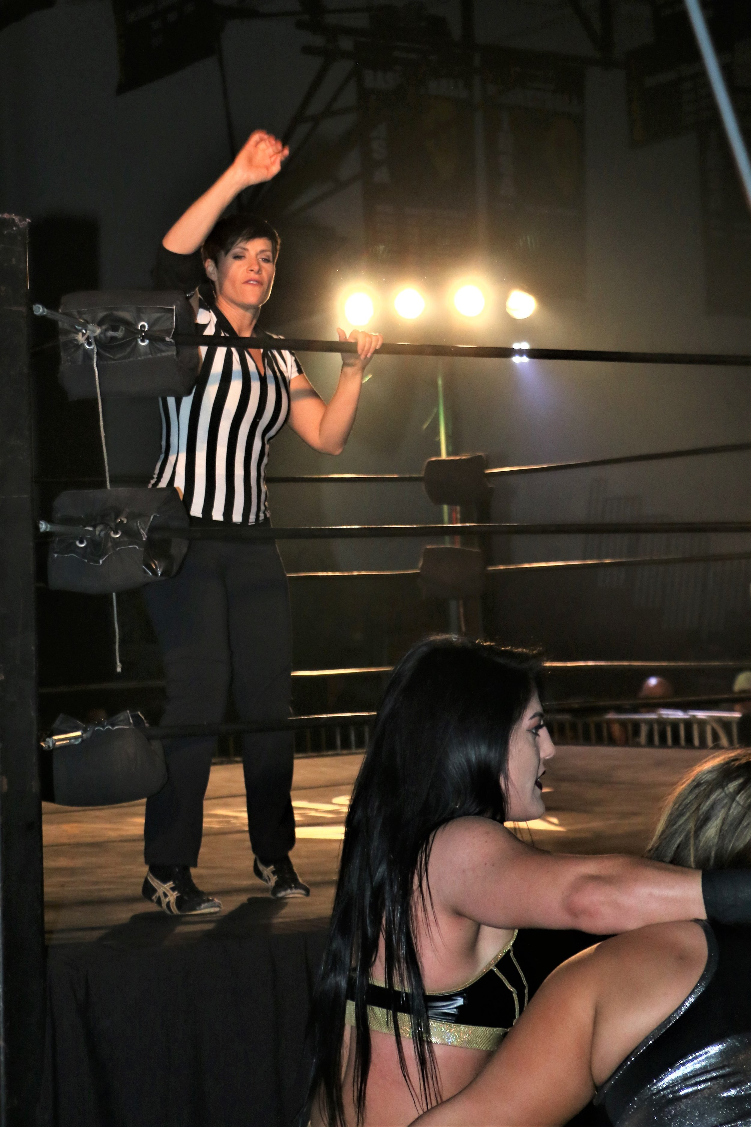 Special referee Molly Holly makes the count on Tessa Blanchard and Jordynne Grace.