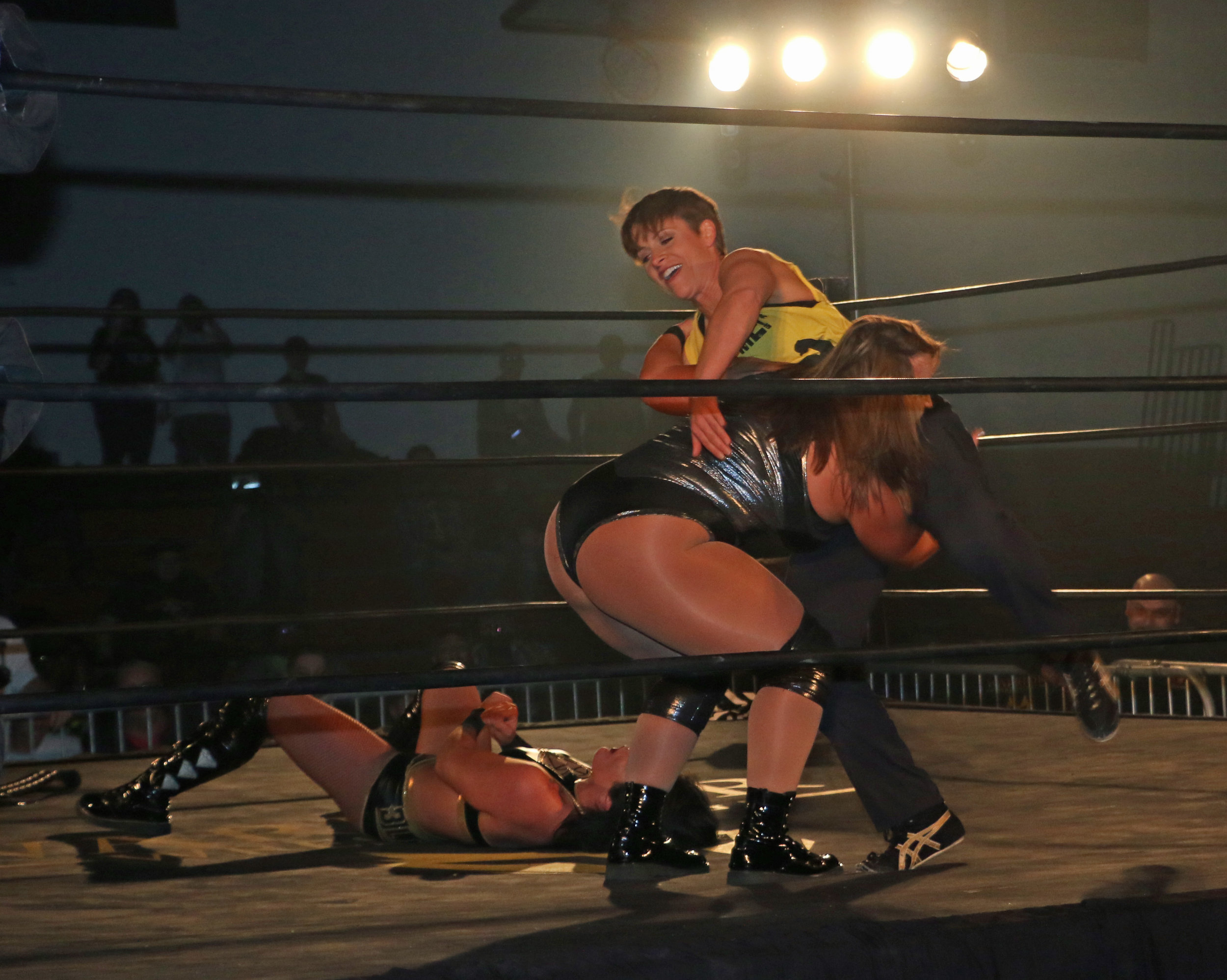 Jordynne Grace scoops up Molly Holly in preparation to slam her onto Tessa Blanchard.