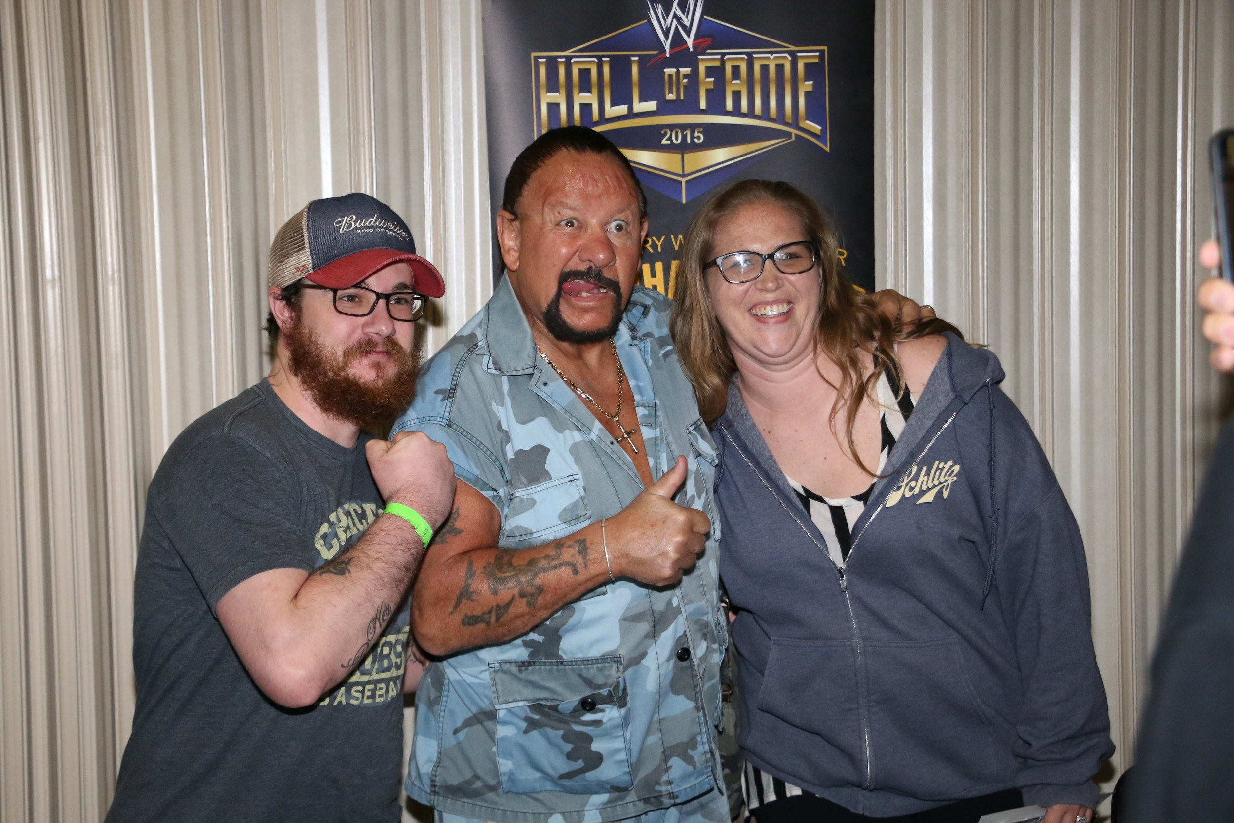 WWE Hall of Famer Bushwhacker Luke poses with fans during the VIP Meet and Greet before the show.