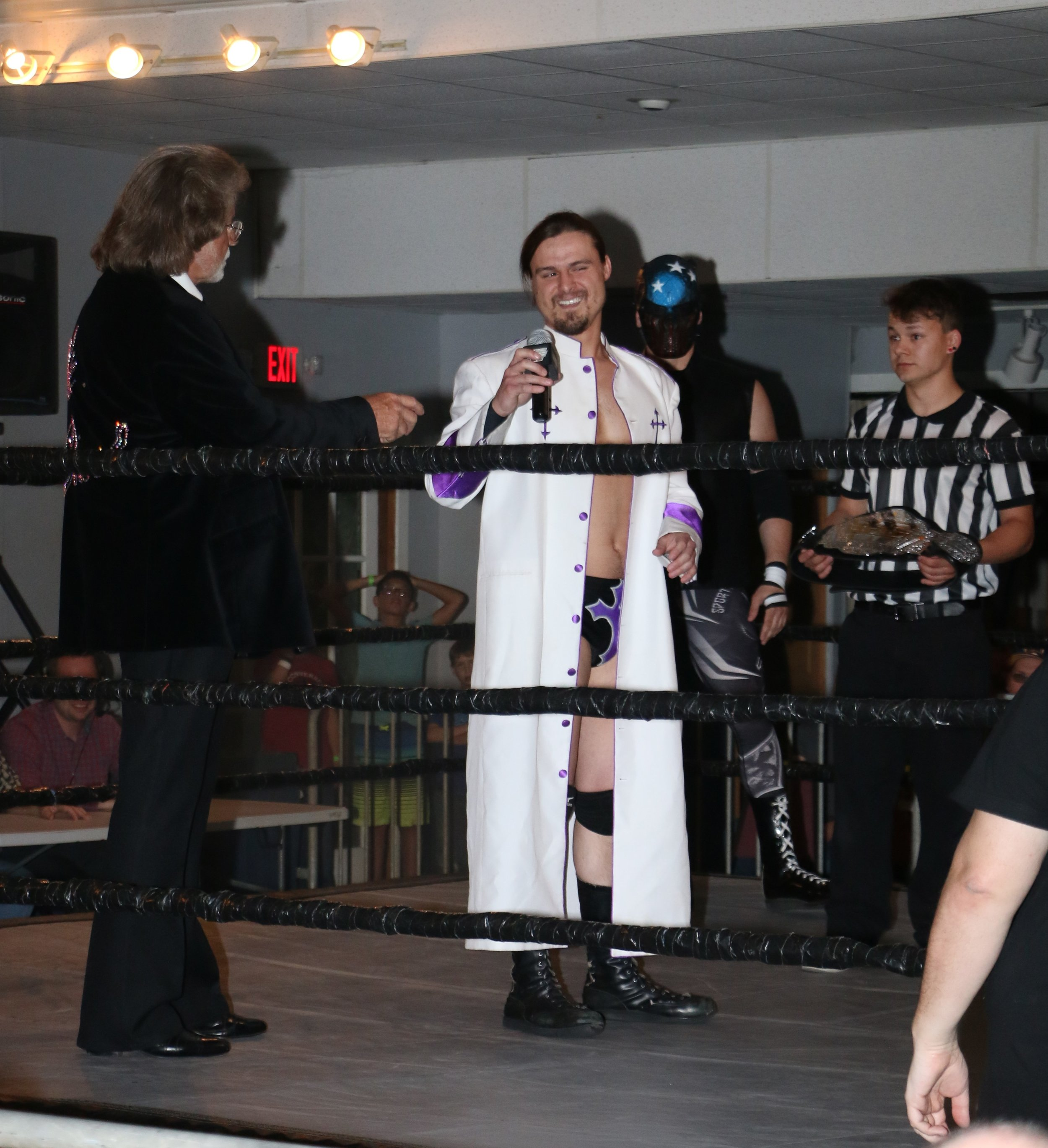 """High Priest"" William Jacobs, with John Fate behind him, seeks an opponent to defend the SSW Championship against."