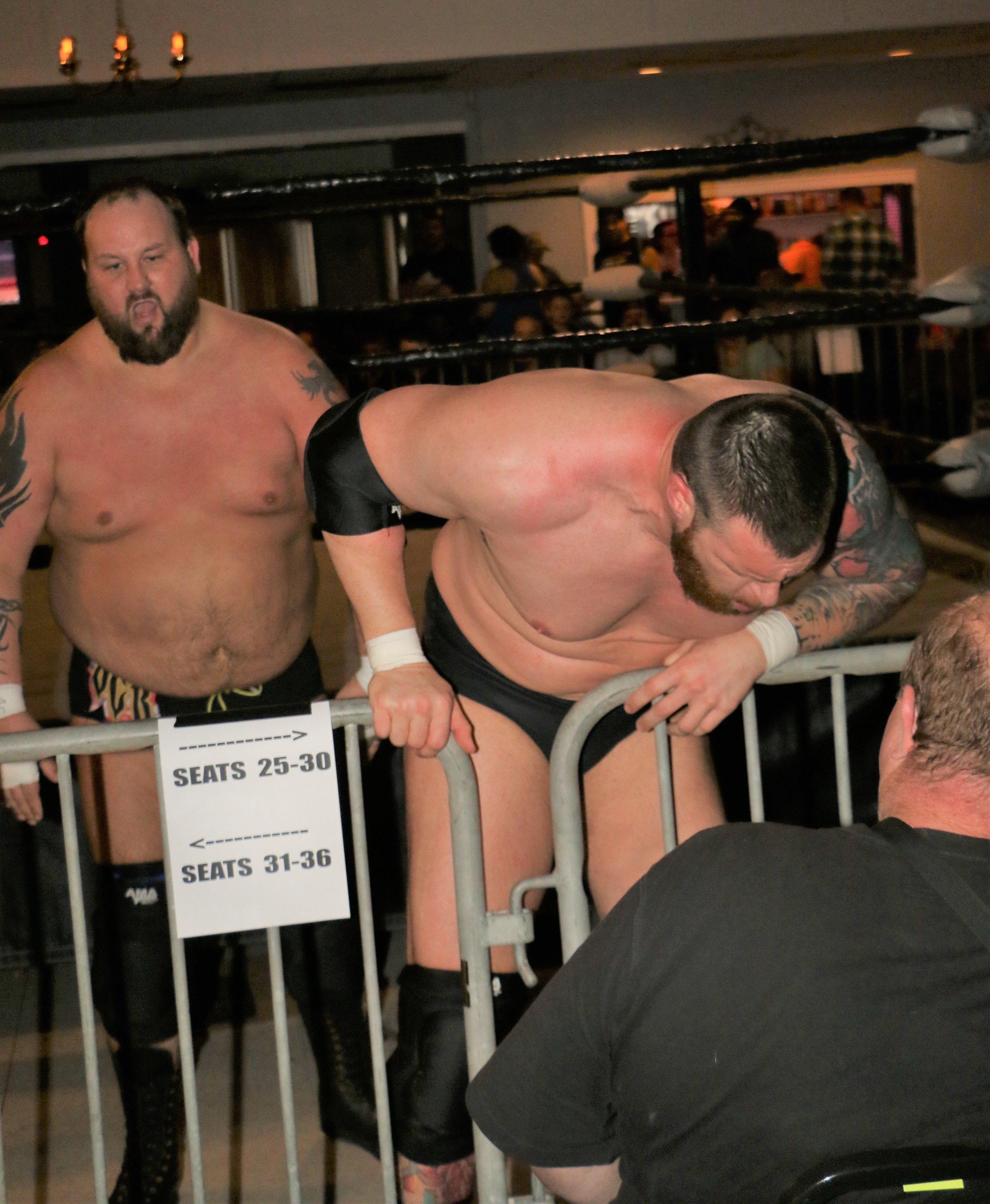 Beer City Bruiser, left, brawls with Jay Bradley on the floor outside the ring.