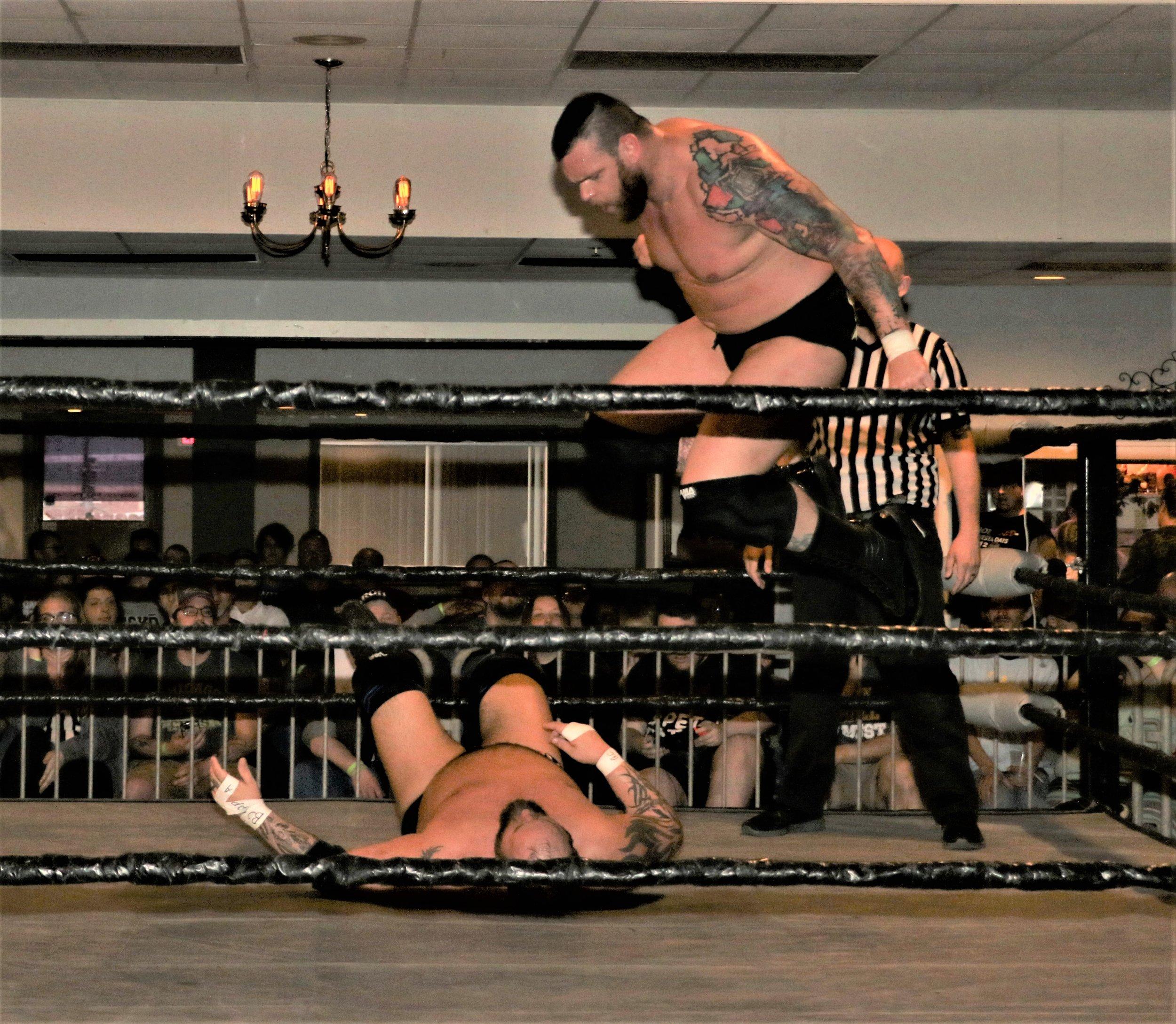 Jay Bradley drops a knee onto Beer City Bruiser.