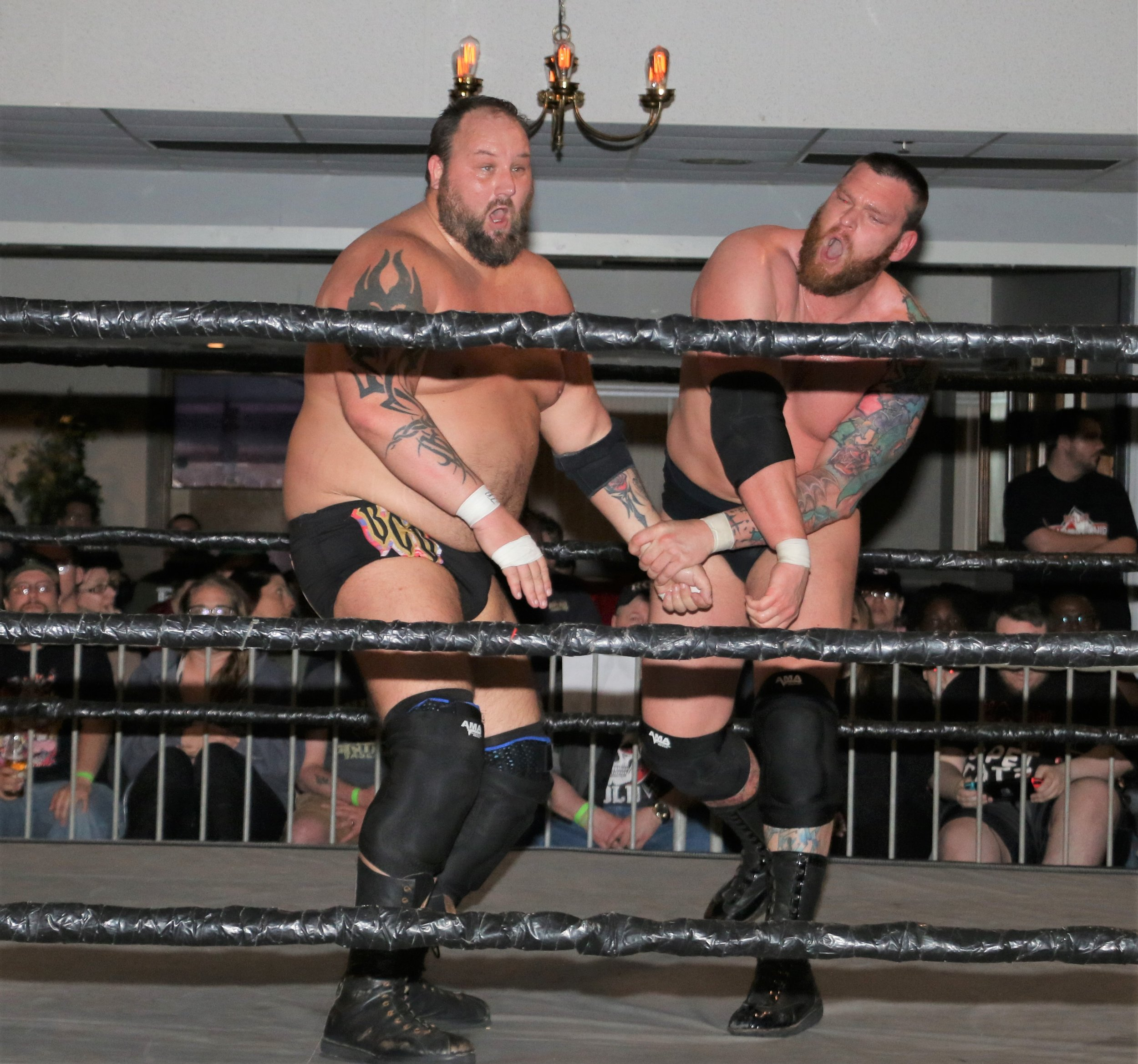 Jay Bradley, right, trades blows with Beer City Bruiser.